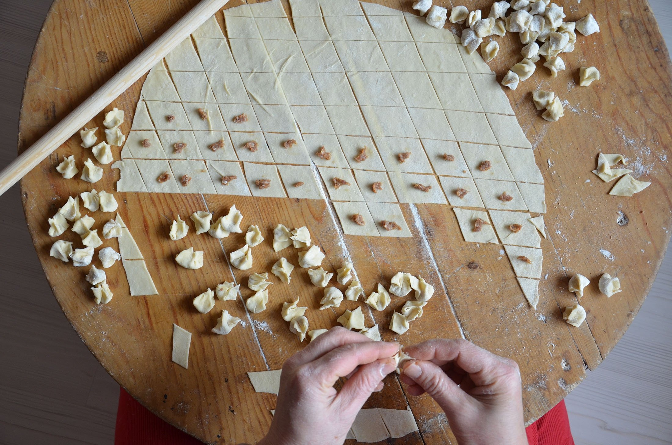 The key to making proper mantı is to keep the filling to a minimum and the pasta squares tiny. (Shutterstock Photo)