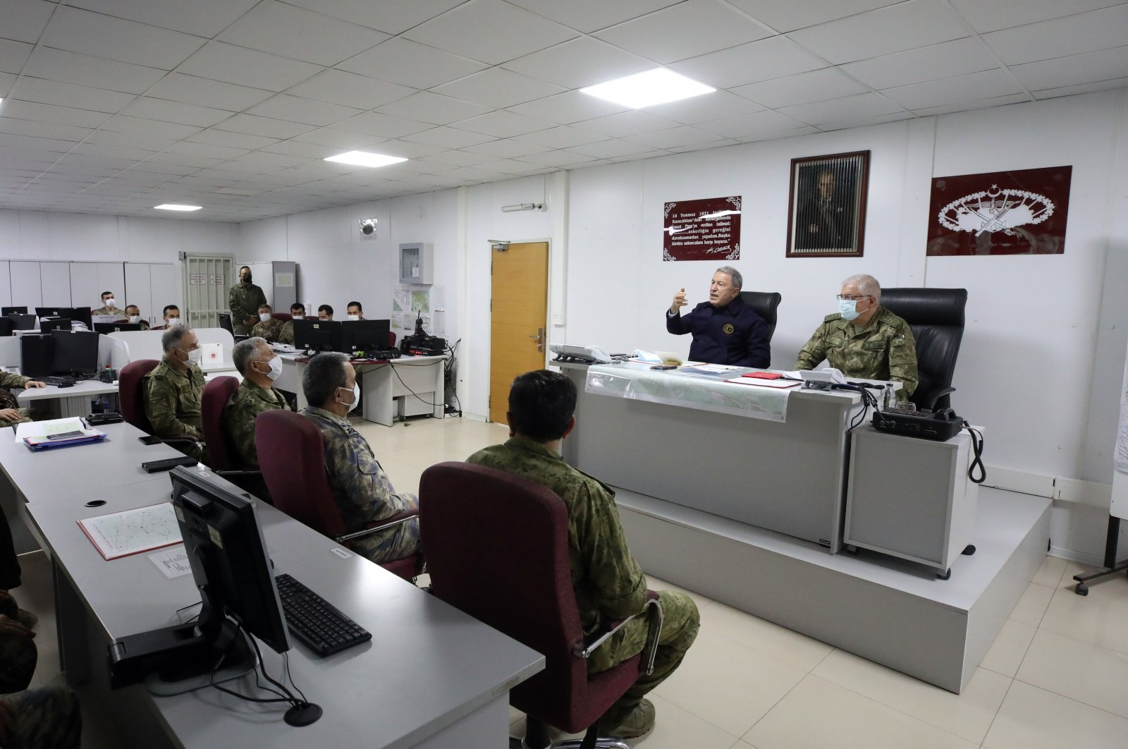 National Defense Minister Hulusi Akar speaks while the top brass and other military officials listen during a meeting at the operation center near the border with Iraq, Feb. 14, 2021. (AA Photo)