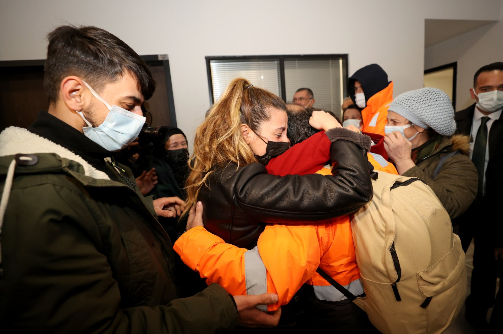 The rescued sailors reunite with their relatives at Istanbul Airport upon arrival in Turkey on Feb. 14, 2021. (AA Photo)