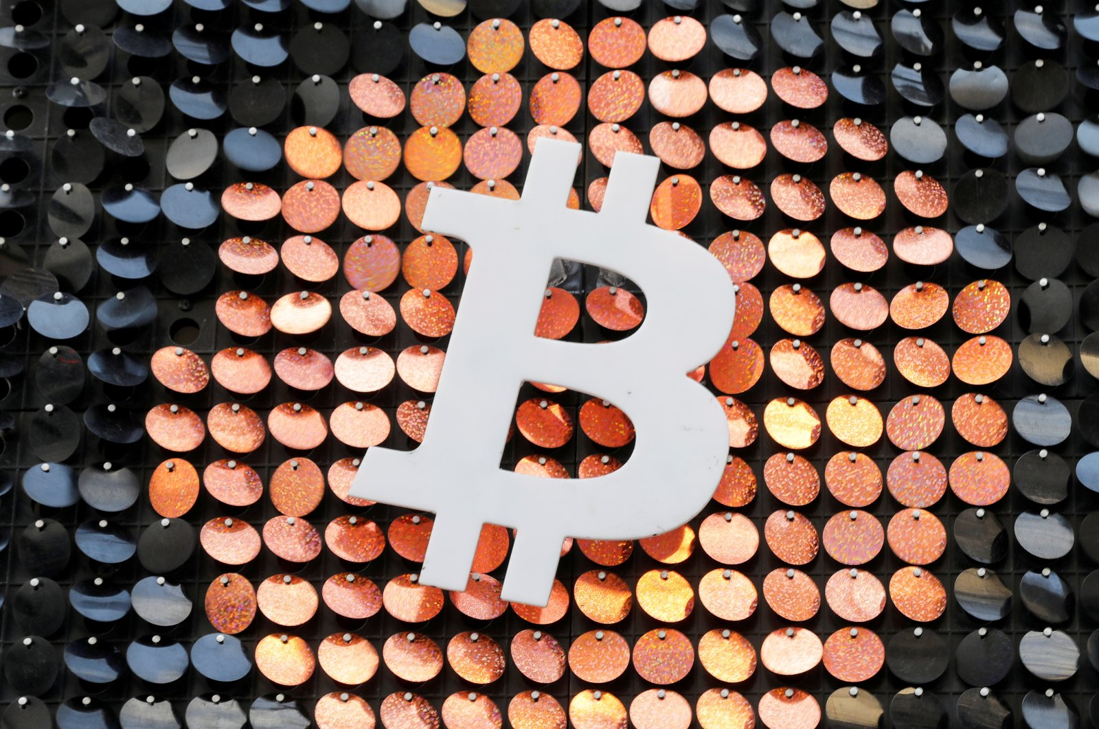 The Bitcoin digital currency logo at a shop in Marseille, France, Feb. 7, 2021. (Reuters Photo)