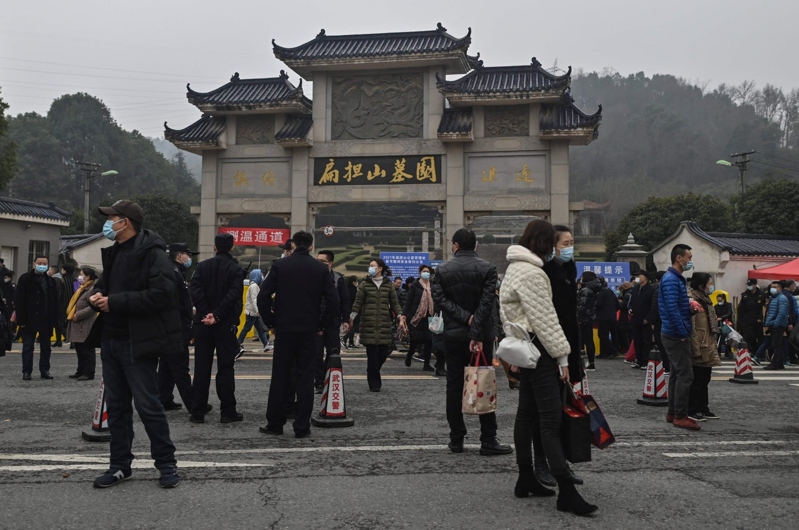 People are seen outside the Biandanshan cemetery in Wuhan, in China's central Hubei province, Feb. 12, 2021. (AFP Photo)