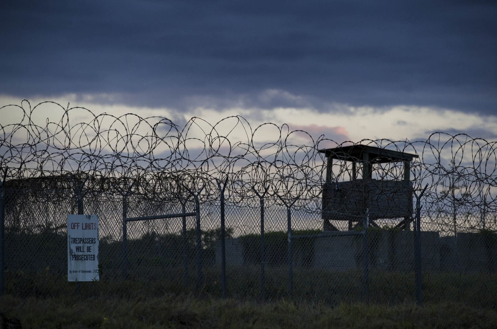 The sun sets behind the closed Camp X-Ray detention facility, at the U.S.' Guantanamo Bay Naval Base, Cuba, April 17, 2019. (AP Photo)