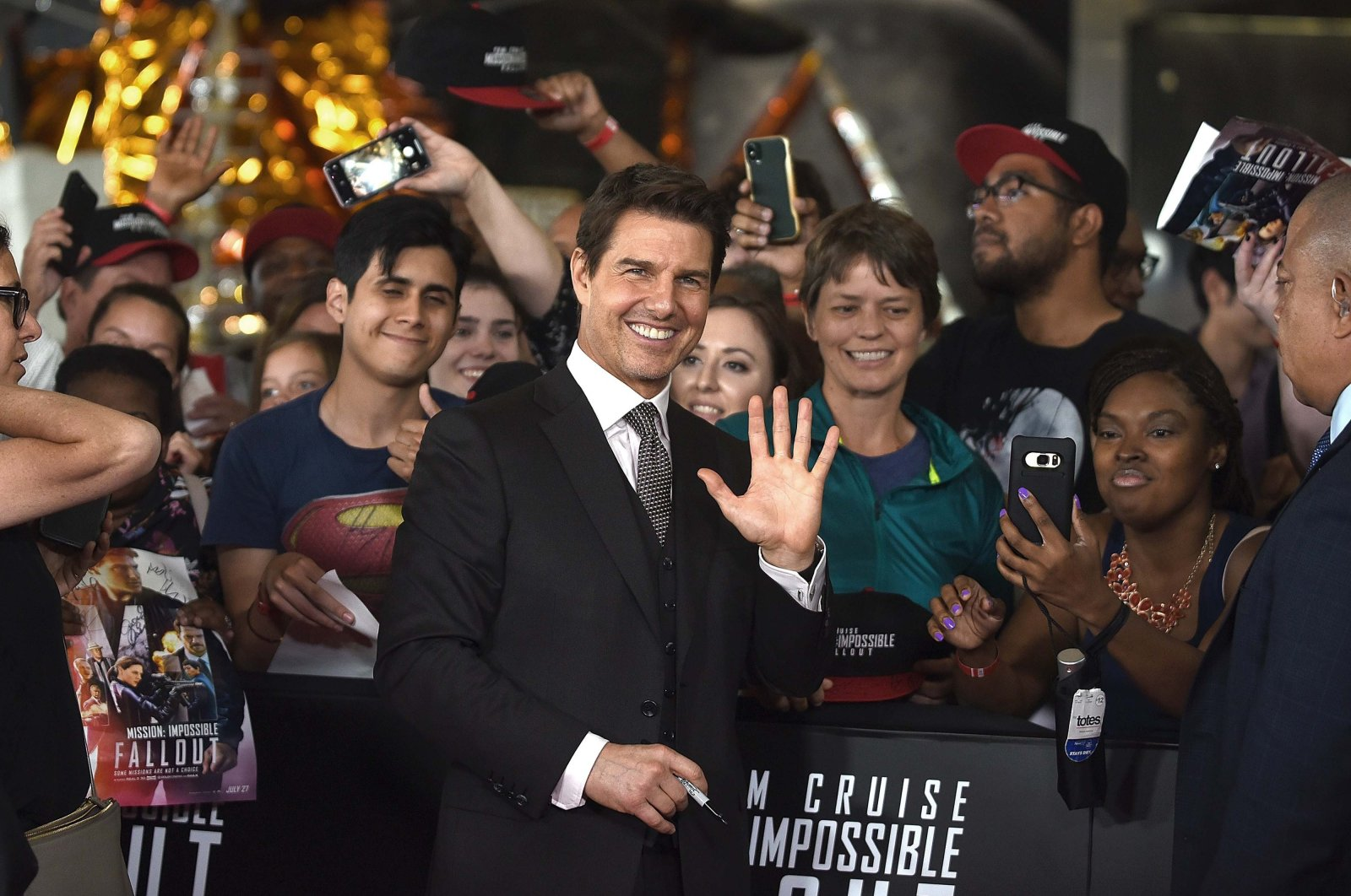 "Tom Cruise greets the fans at the U.S. Premiere of ""Mission: Impossible - Fallout"" at Smithsonian's National Air and Space Museum in Washington, D.C., the U.S., July 22, 2018. (Getty Images via AFP)"