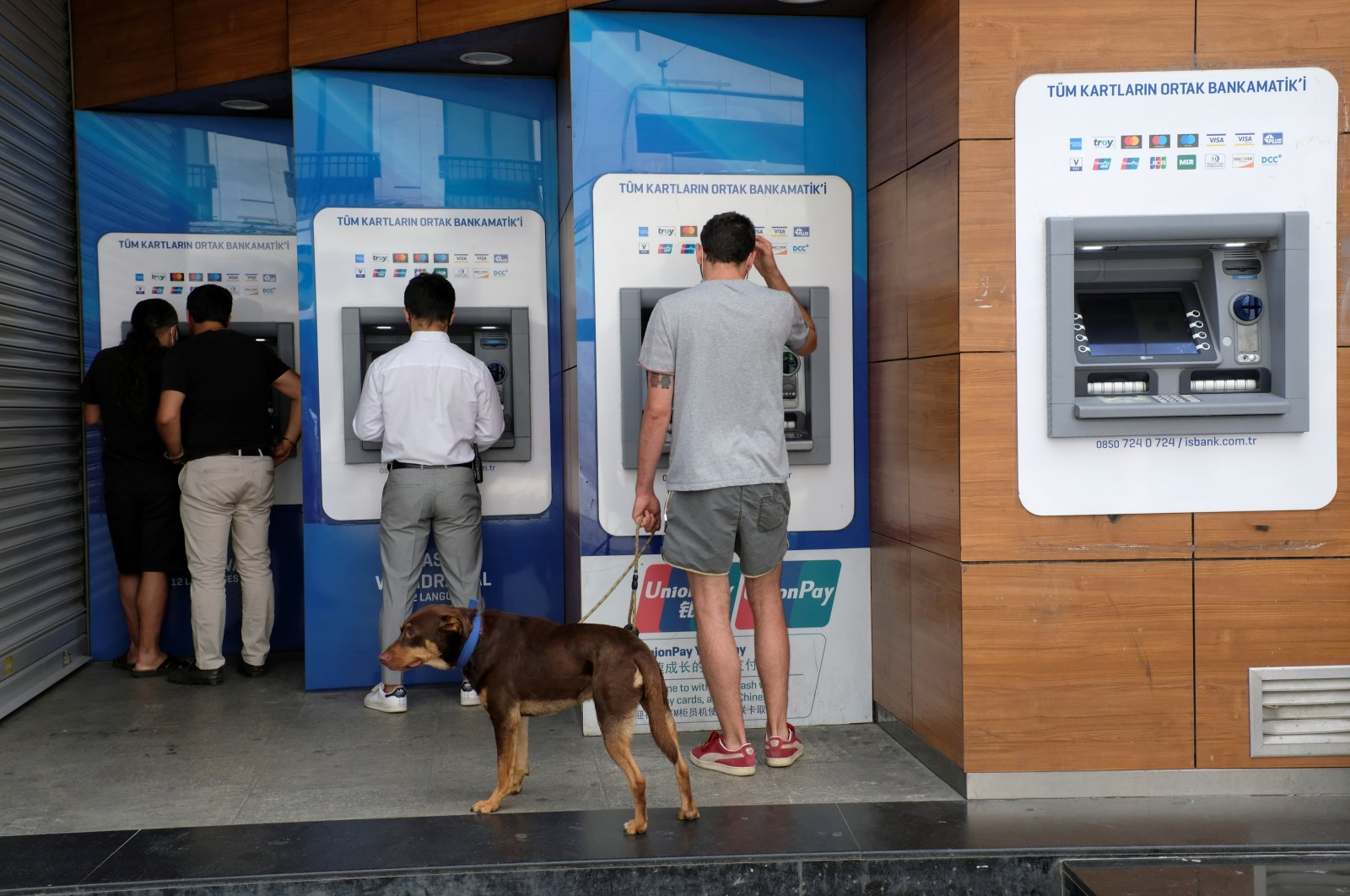 People withdraw money from ATM machines at the main shopping and pedestrian street of Istiklal Avenue in central Istanbul, Turkey, July 25, 2020. (Reuters Photo)