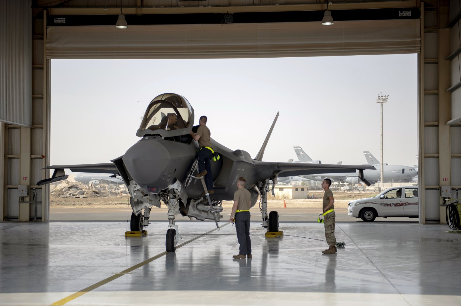 In this photo released by the U.S. Air Force, an F-35 fighter jet pilot and crew prepare for a mission at Al-Dhafra Air Base in the United Arab Emirates, Aug. 5, 2019. (AP Photo)