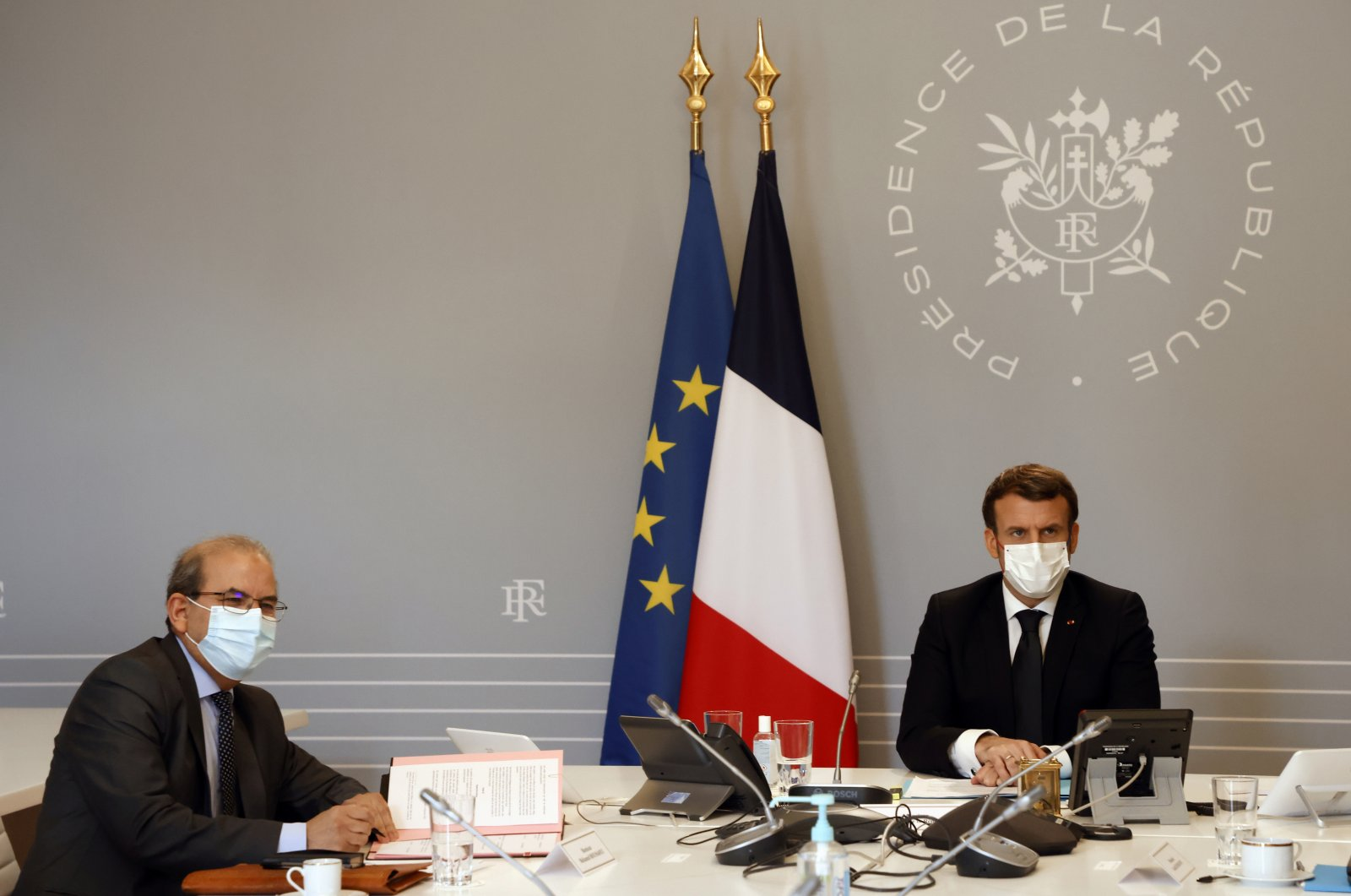 """Mohammed Moussaoui, president of the French Council of the Muslim Faith (CFCM) signs a """"Charter of principles"""" next to French President Emmanuel Macron, at the Elysee palace in Paris, France on Jan. 18, 2021. (Reuters Photo)"""
