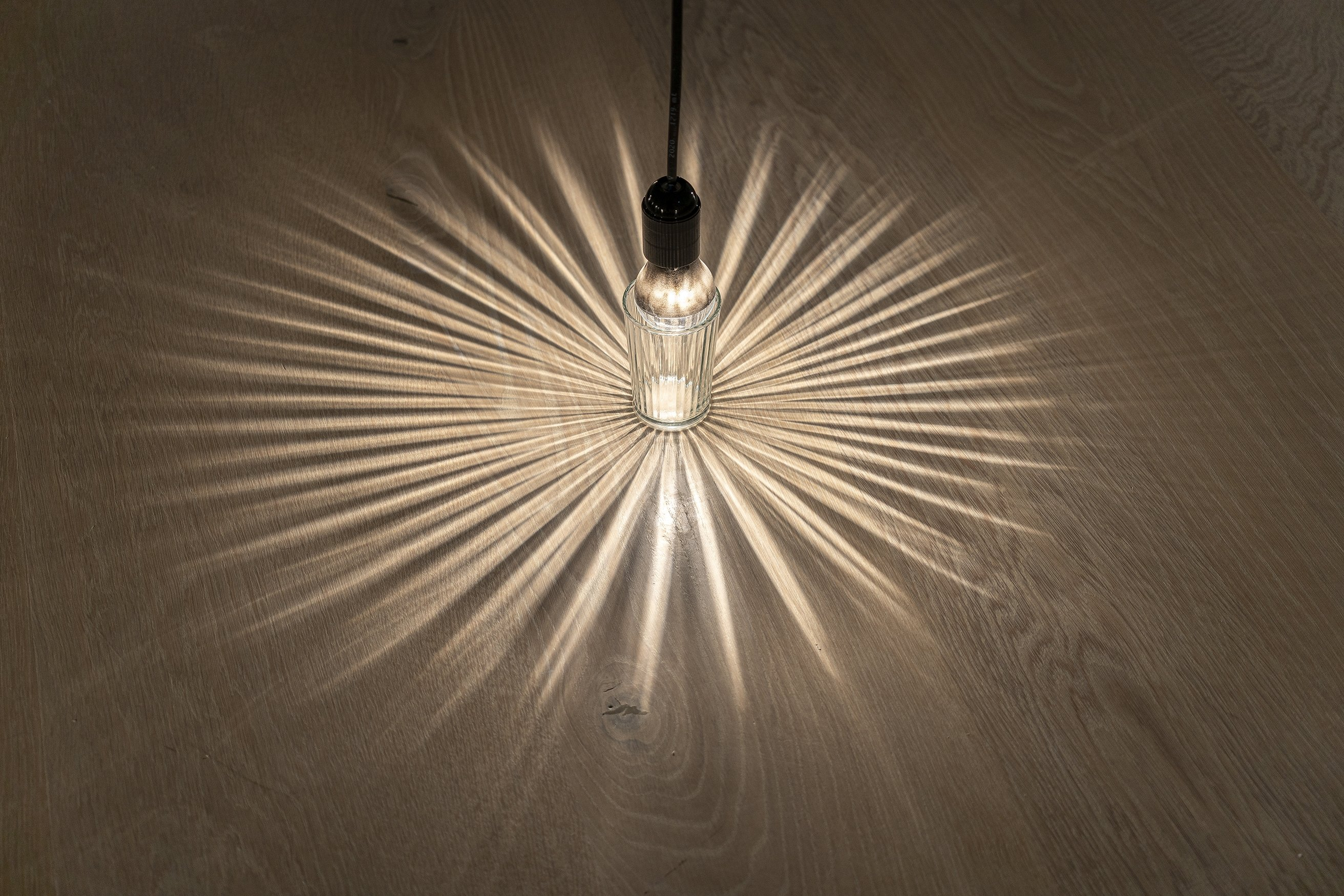 Annette Ruenzler, untitled, 2013, sanded light bulbs, glasses, pitcher, cables, luster terminals. (Courtesy of Arter)