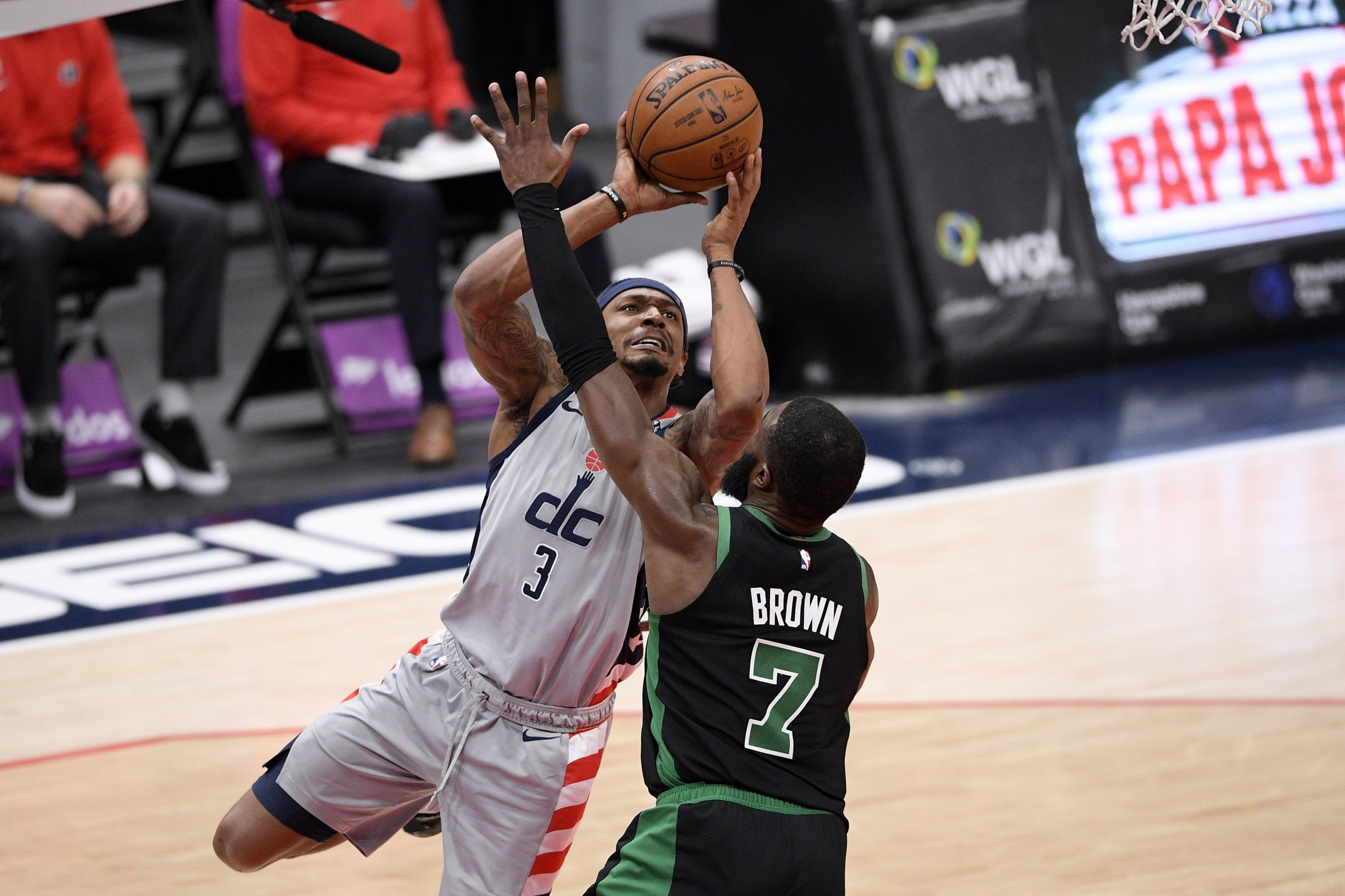 Washington Wizards guard Bradley Beal (L) goes for the basket against Boston Celtics guard Jaylen Brown (R) during the second half of an NBA game, Washington, U.S., Feb. 14, 2021. (AP Photo)