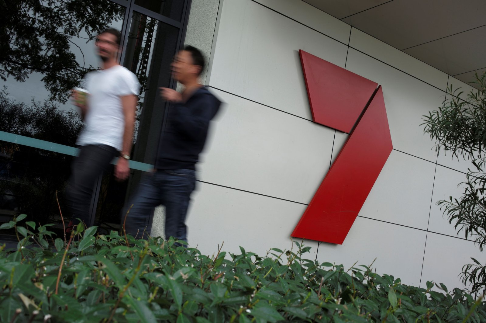 Workers walk past the headquarters of media broadcaster/publisher Seven West Media in Sydney, Australia on Feb. 14, 2017. (Reuters Photo)