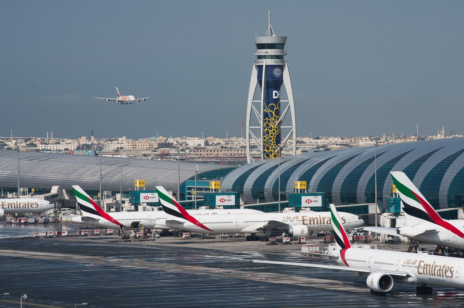 An Emirates jetliner comes in for landing at Dubai International Airport in Dubai, United Arab Emirates, Dec. 11, 2019. (AP Photo)