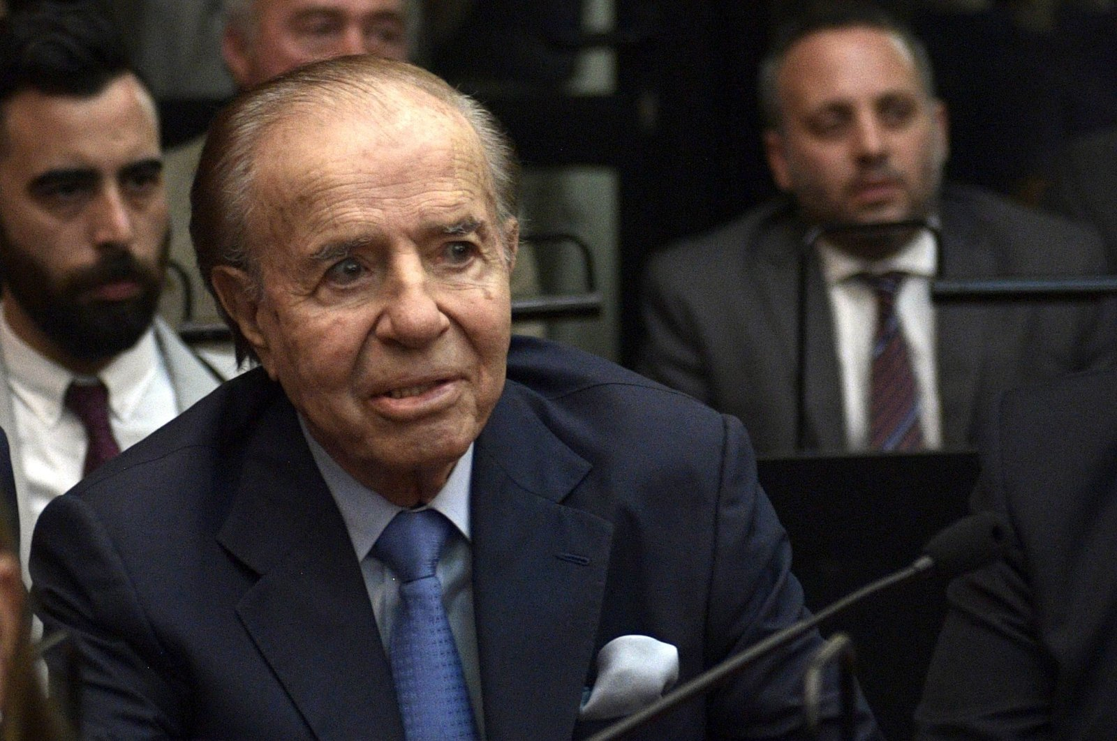 In this file photo Argentine former president and current senator Carlos Menem gestures before hearing his sentence during his trial over accusations of attempting to block the 1994 AMIA bombing investigation, in Buenos Aires taken on Feb. 28, 2019. (AP Photo)