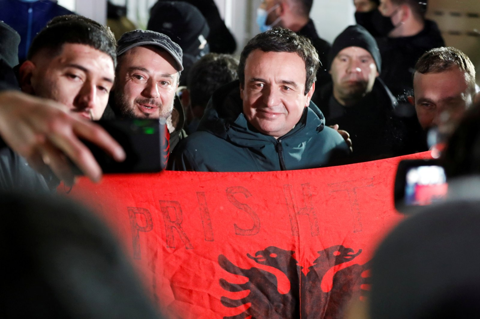 Vetevendosje! party leader Albin Kurti poses for a photo with supporters after preliminary results of the parliamentary election in Pristina, Kosovo, Feb. 15, 2021. (Reuters Photo)