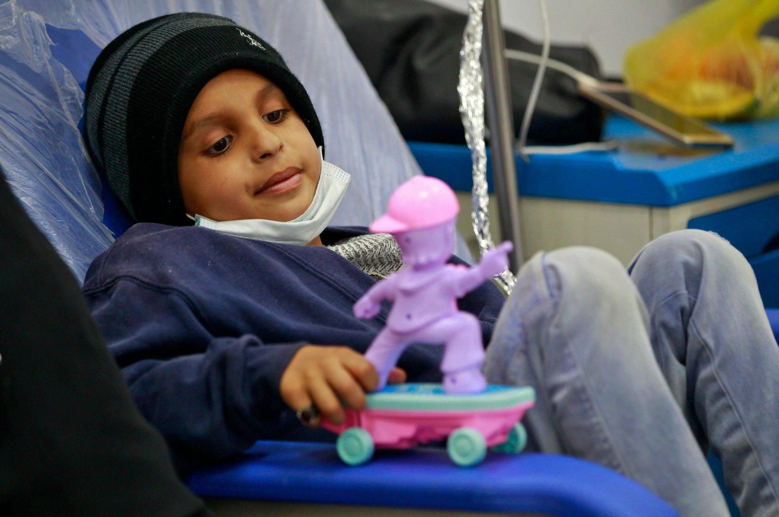 A child suffering from blood cancer, or leukemia, receives treatment at an oncology ward of a hospital in the Yemeni capital Sanaa, on World Cancer Day, Feb. 4, 2021. (AFP Photo)