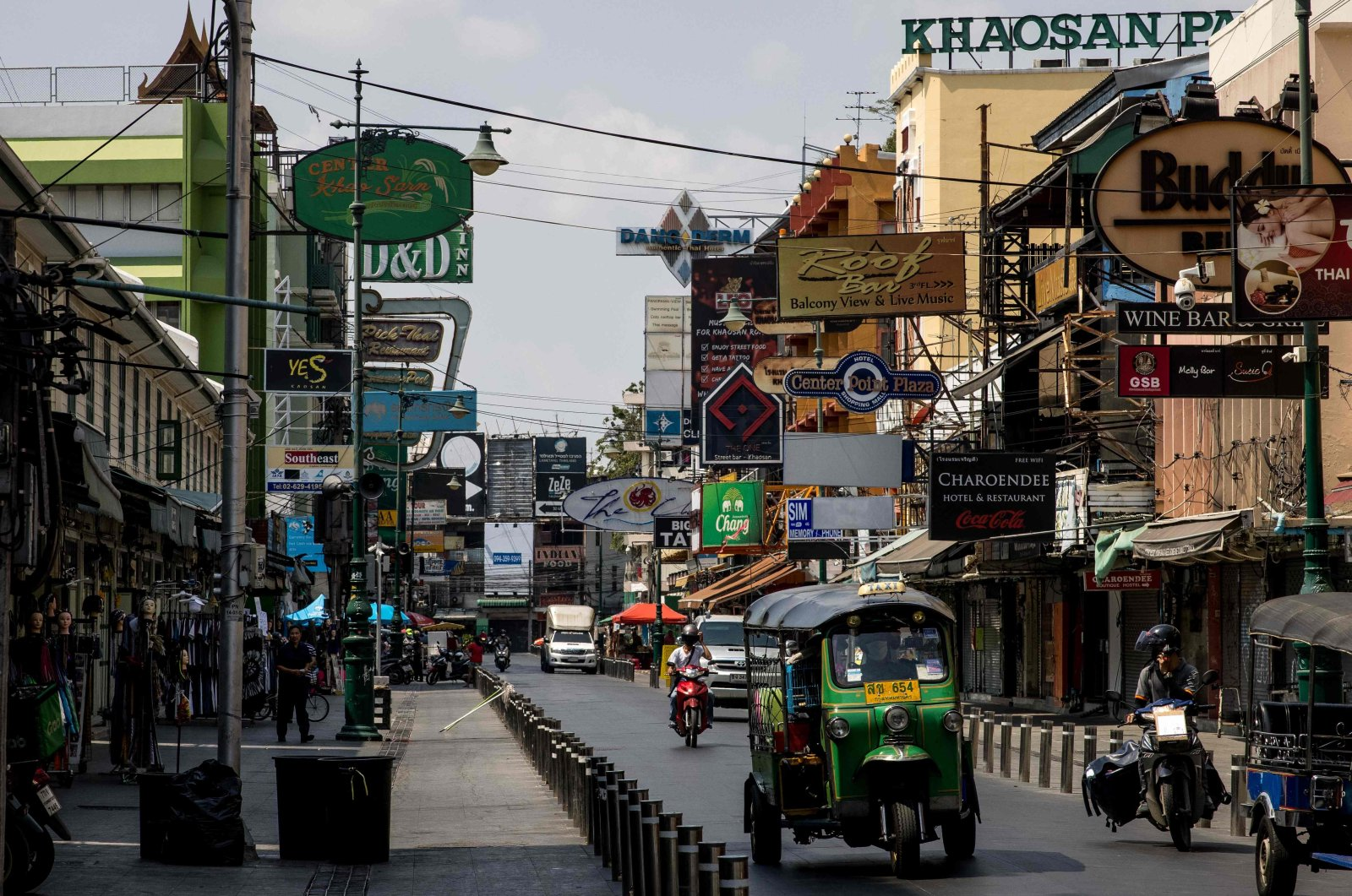 A tuk-tuk drives down Khao San Road, a once-popular tourist strip in Bangkok, Thailand, Feb. 15, 2021, as the country records it worst economic performance in more than two decades. (AFP Photo)