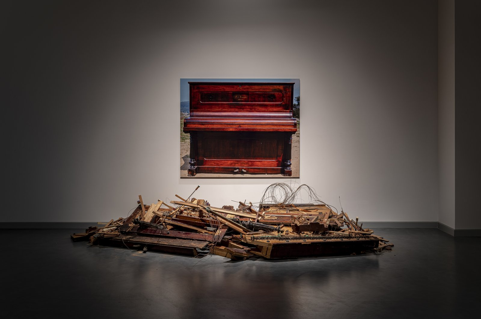 """Carles Santos, """"Destroyed Piano with Photograph,"""" 2008, destroyed piano, color photography. (Courtesy of Arter)"""