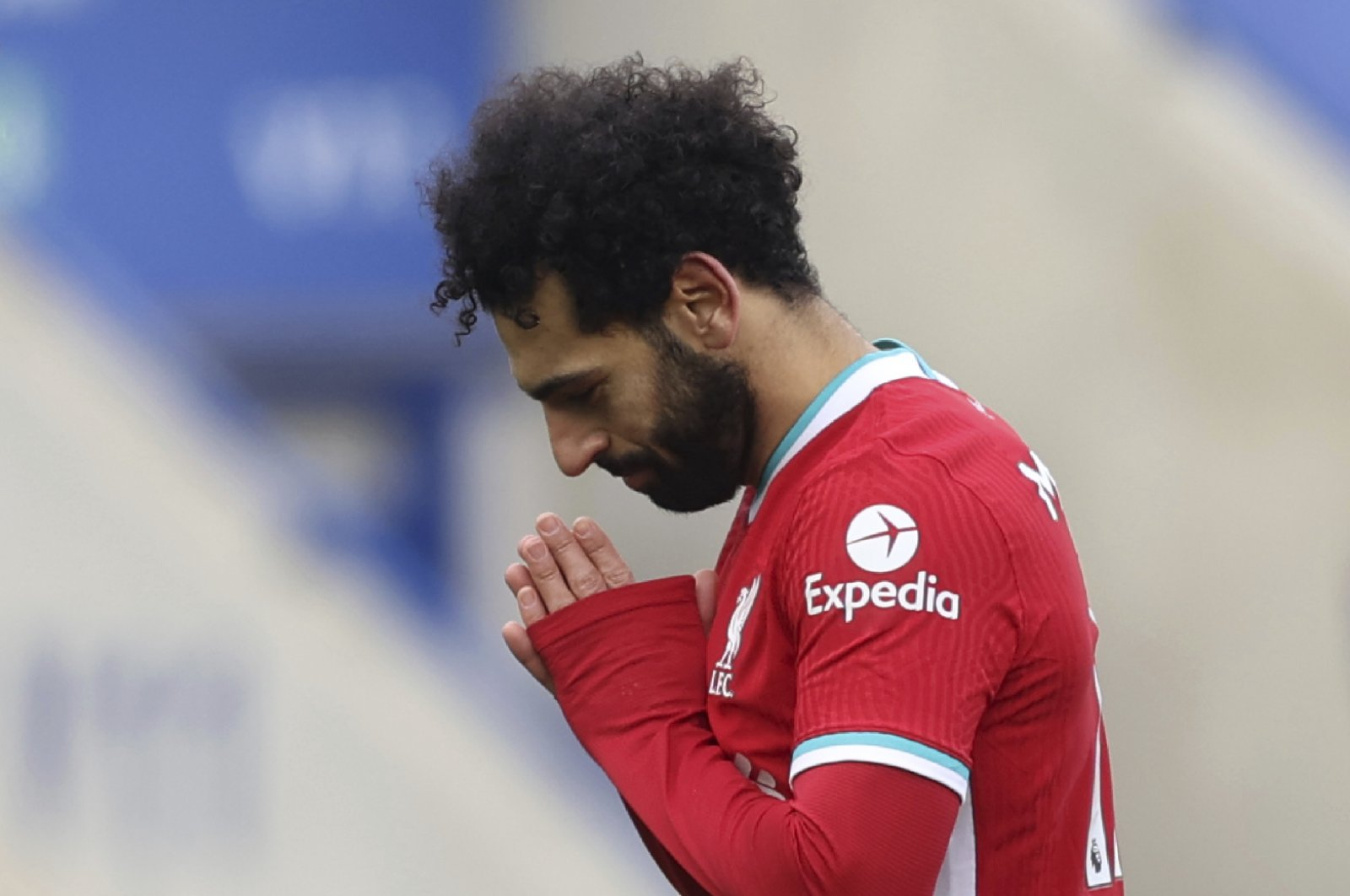 Liverpool's Mohamed Salah (R) celebrates scoring a goal against Leicester City at the King Power Stadium, Leicester, England, Feb. 13, 2021. (AP Photo)