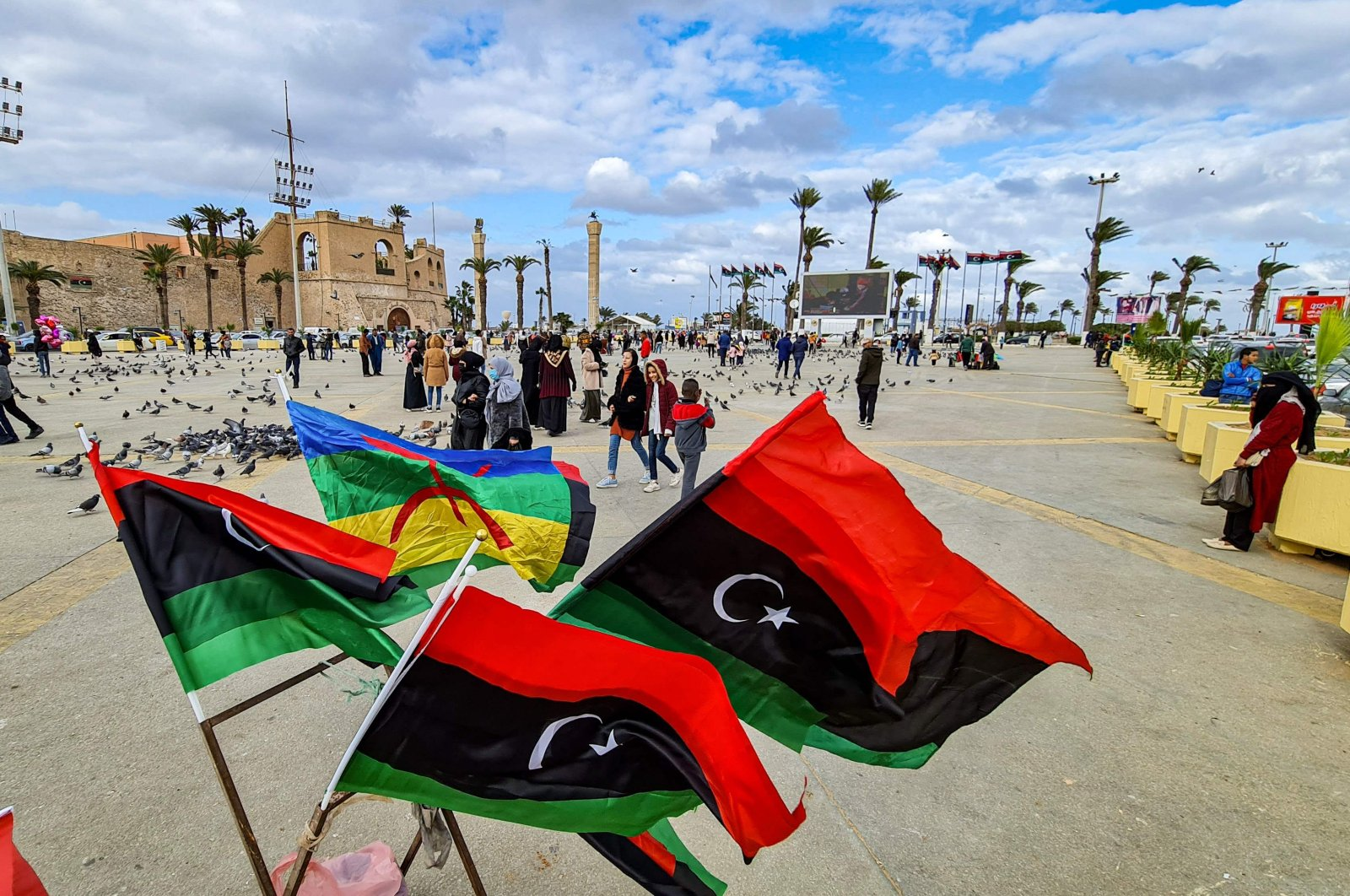Amazigh and Libyan national flags are seen fluttering at the Martyrs' Square in the center of Libya's capital Tripoli, Feb. 14, 2021. (AFP Photo)