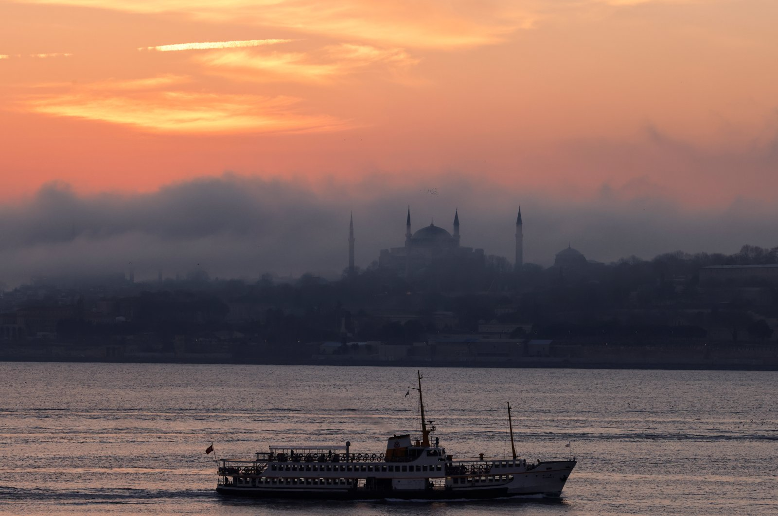 A ferry sails through the Bosporus with the Hagia Sophia Grand Mosque in the background during a two-day curfew amid the spread of the coronavirus, in Istanbul, Turkey, Feb. 6, 2021. (Reuters Photo)