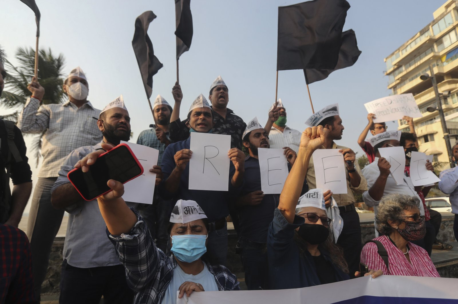 Members of Aam Aadmi Party shout slogans demanding the release of Indian climate activist Disha Ravi, during a protest in Mumbai, India, Feb. 15, 2021. (AP Photo)