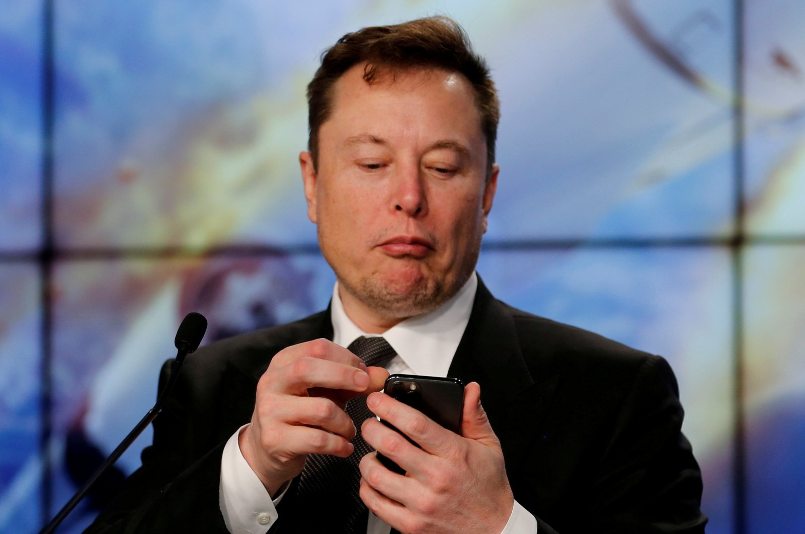 Elon Musk looks at his mobile phone during a post-launch news conference at the Kennedy Space Center in Cape Canaveral, Florida, U.S. Jan. 19, 2020. (Reuters Photo)