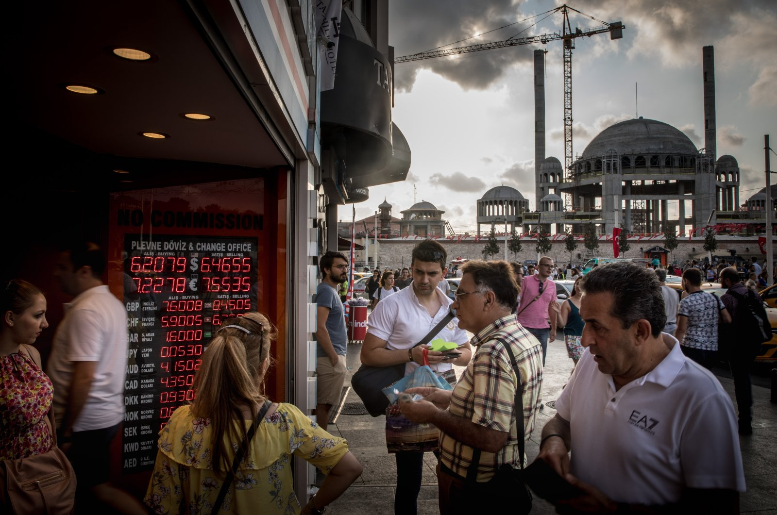 People wait outside a currency exchange office in Taksim Square, in Istanbul, Turkey, Aug. 29, 2018. (Getty Images)