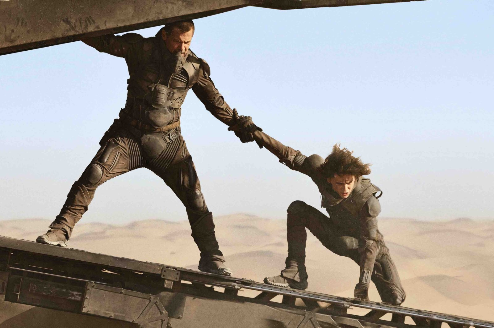 """This image released by Legendary Pictures shows Josh Brolin (L) and Timothee Chalamet in """"Dune."""" (Photo courtesy of Legendary Pictures / Warner Bros)"""