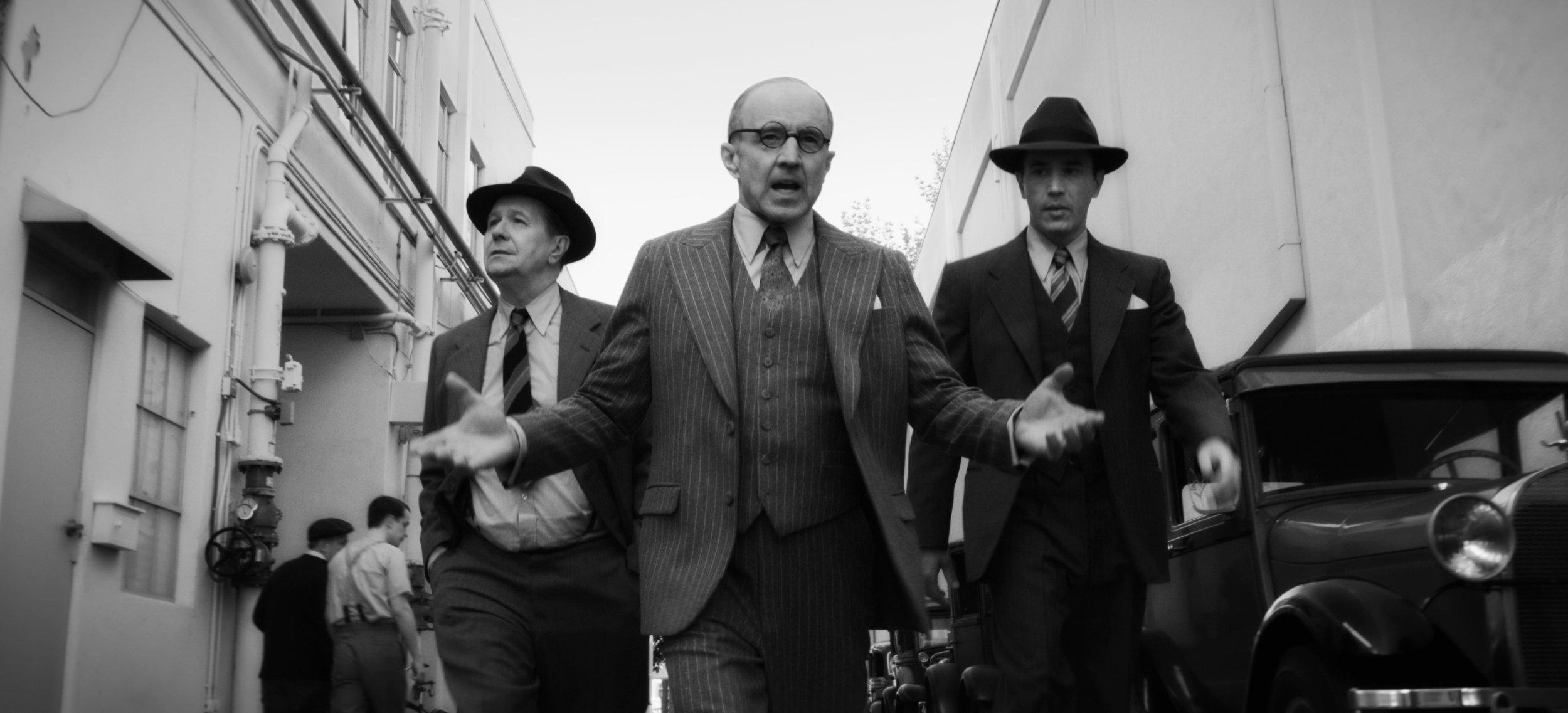 Gary Oldman as Herman Mankiewicz, Arliss Howard as Louis B. Mayer and Tom Pelphrey as Joe Mankiewicz in a scene from