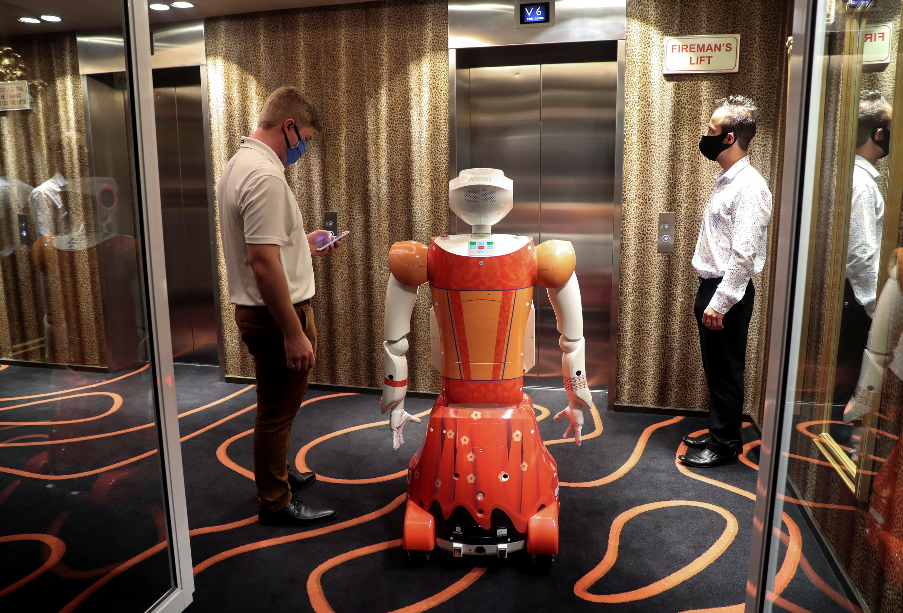 AI-powered robot Ariel waits for a lift before delivering room service at Hotel Sky, the first in Africa to use automated attendants, in Johannesburg, South Africa, Feb. 9, 2021. (Reuters Photo)