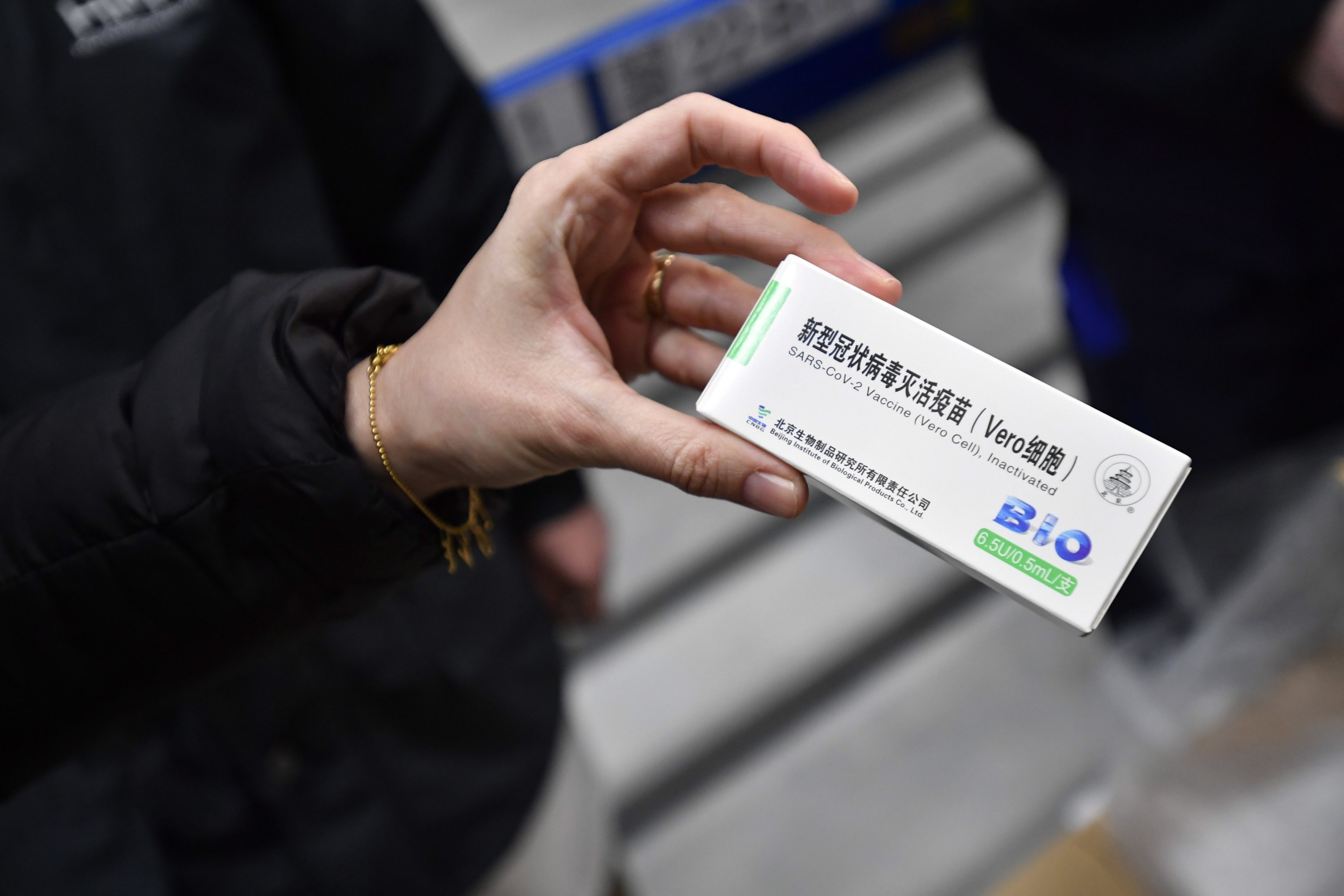A packet containing vials of the vaccine against COVID-19 produced by China' Sinopharm is displayed in the logistics center of Hungarian pharmaceutical wholesaler Hungaropharma in Budapest, Hungary, 16 Feb. 16, 2021 (EPA Photo)