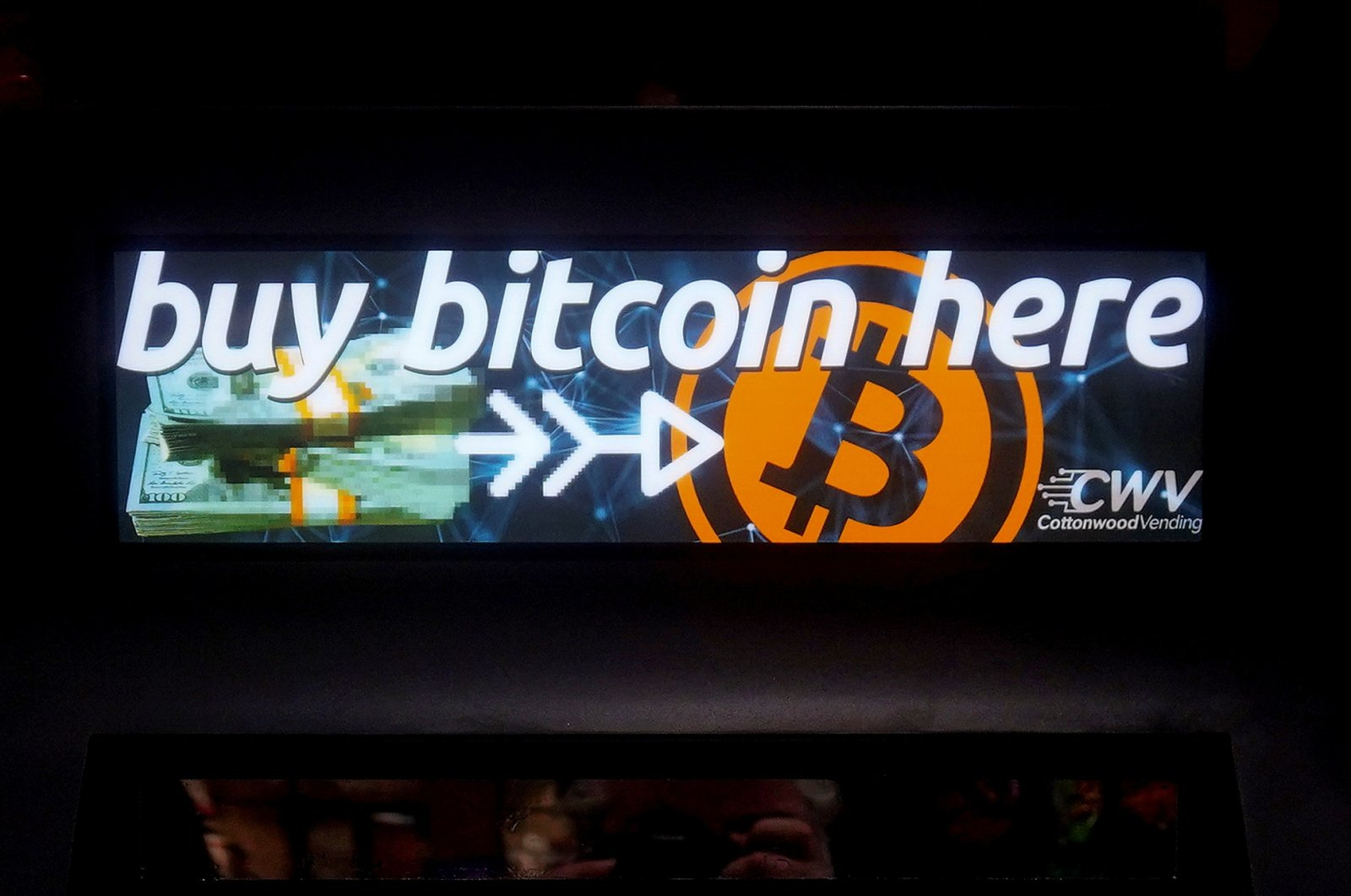 A Bitcoin ATM sign is pictured in a bodega in the Manhattan borough of New York City, New York, U.S., Feb. 9, 2021. (Reuters Photo)