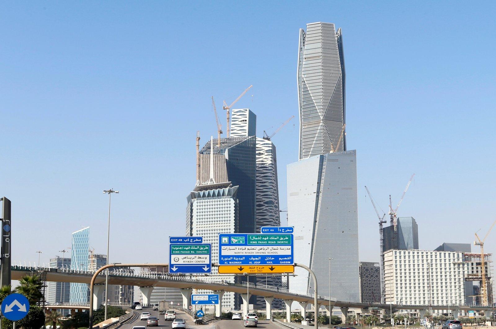 Cars drive past the King Abdullah Financial District in Riyadh, Saudi Arabia, Dec. 18, 2018. (Reuters Photo)