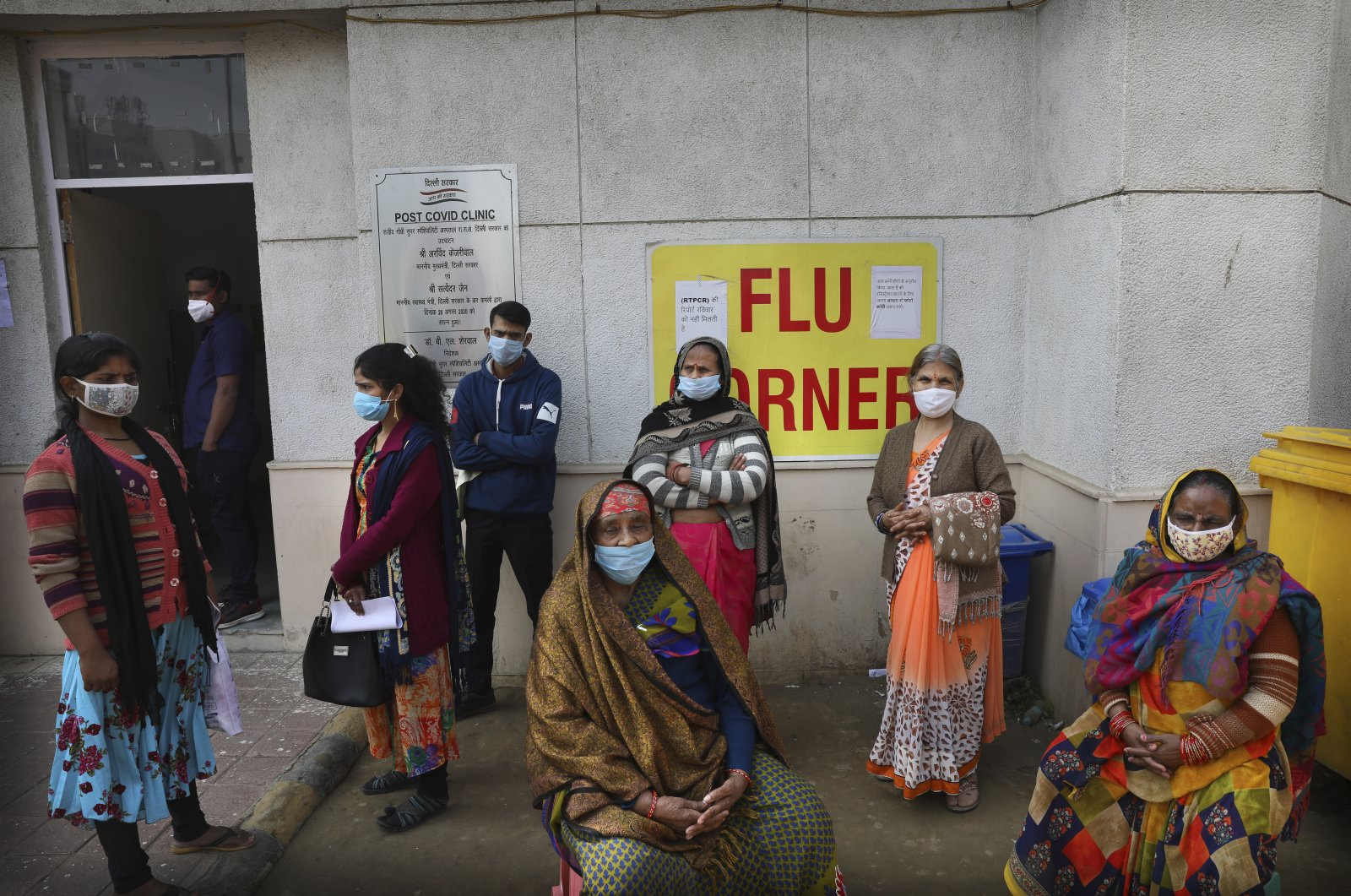 People wait outside a health center to get tested for COVID-19 in New Delhi, India, Feb. 11, 2021. (AP Photo)