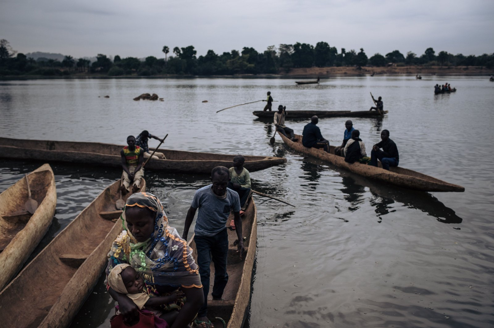Central African refugees arrive in Ndu after crossing the Mbomou River, which marks the border between the Central African Republic and the Democratic Republic of Congo, on Feb. 5, 2021. (AFP Photo)