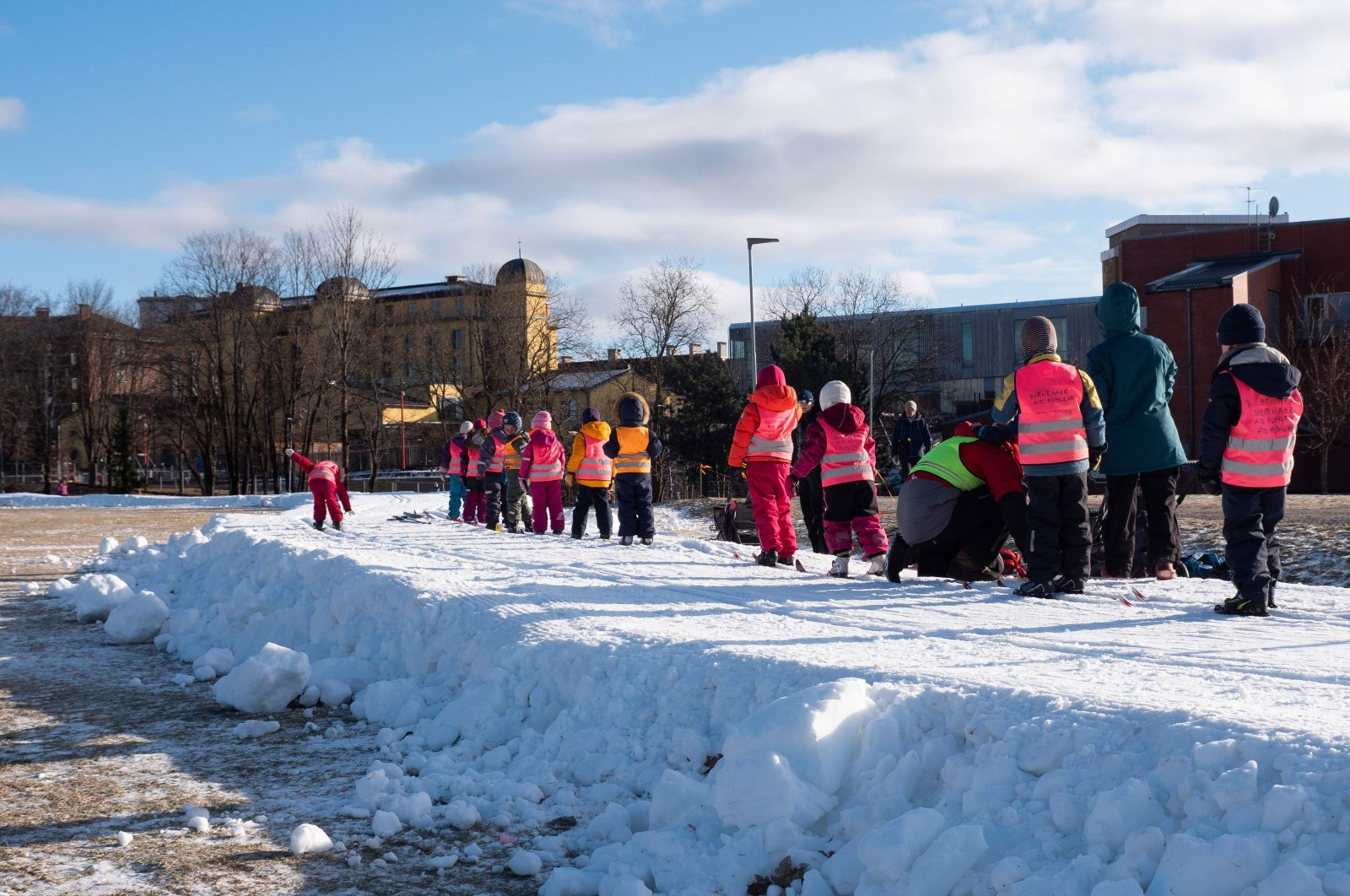 Children on excursions with their daycare groups, cross-country skiing on trails made of artificial snow in Oslo, Norway, Feb. 10, 2021. (AFP Photo)