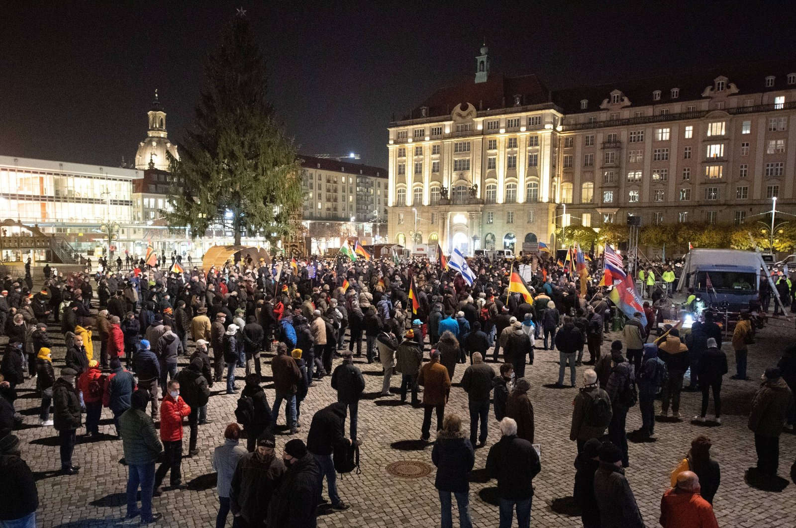Participants stand in front of the Frauenkirche during a rally of the Islamophobic and xenophobic Pegida movement on the Altmarkt in front of the Frauenkirche, Nov. 9, 2020. (Getty Images)