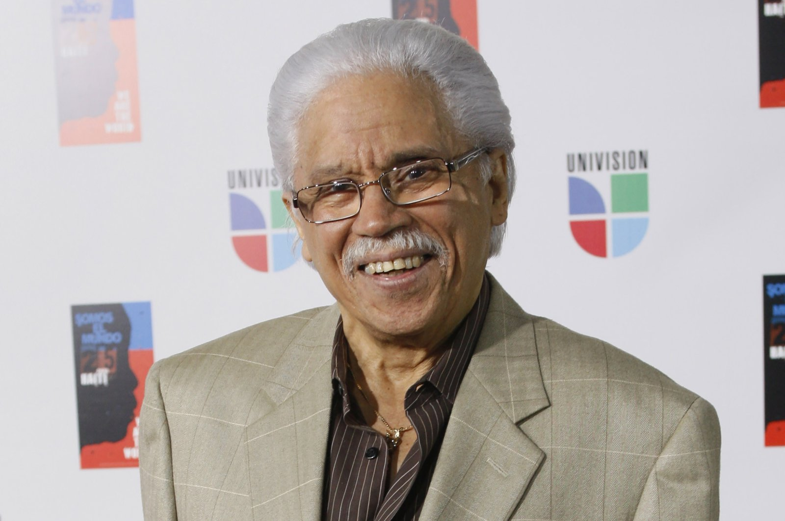 In this file photo, Dominican artist Johnny Pacheco poses for photographers in Miami, Florida, U.S., Feb. 19, 2019 (AP PHOTO)