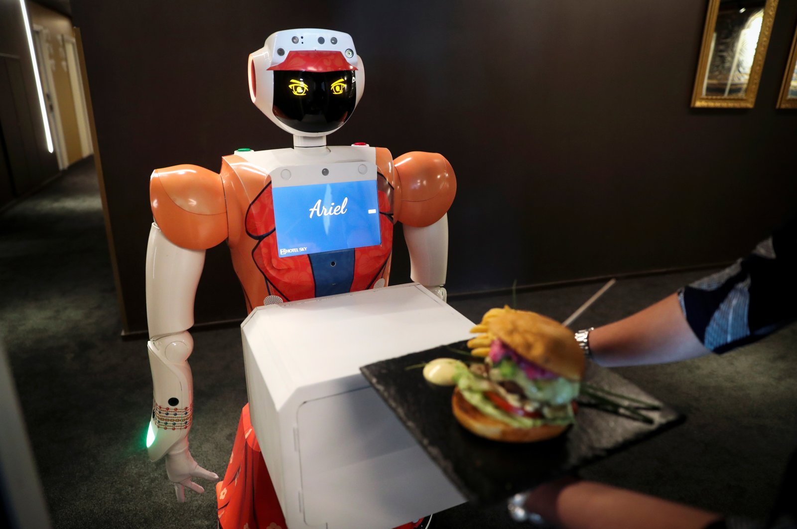 AI-powered robot Ariel delivers room service to a guest at Hotel Sky, the first in Africa to use automated attendants, in Johannesburg, South Africa, Feb. 9, 2021. (Reuters Photo)