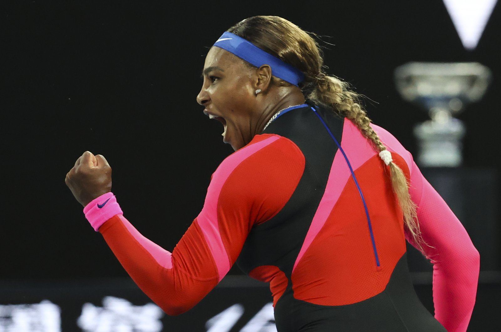 U.S.' Serena Williams reacts after winning a point against Romania's Simona Halep during their quarterfinal match at the Australian Open tennis championship in Melbourne, Australia, Feb. 16, 2021. (AP Photo)