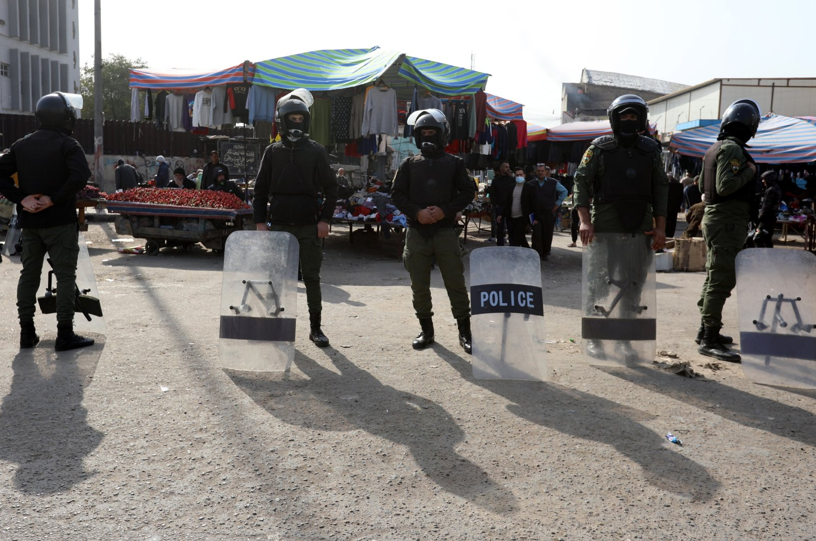 Police forces stand guard as Iraqis protest at the site of a suicide bomb attack that targeted a popular market on Jan. 21, Baghdad, Iraq, Jan. 25, 2021. (EPA File Photo)