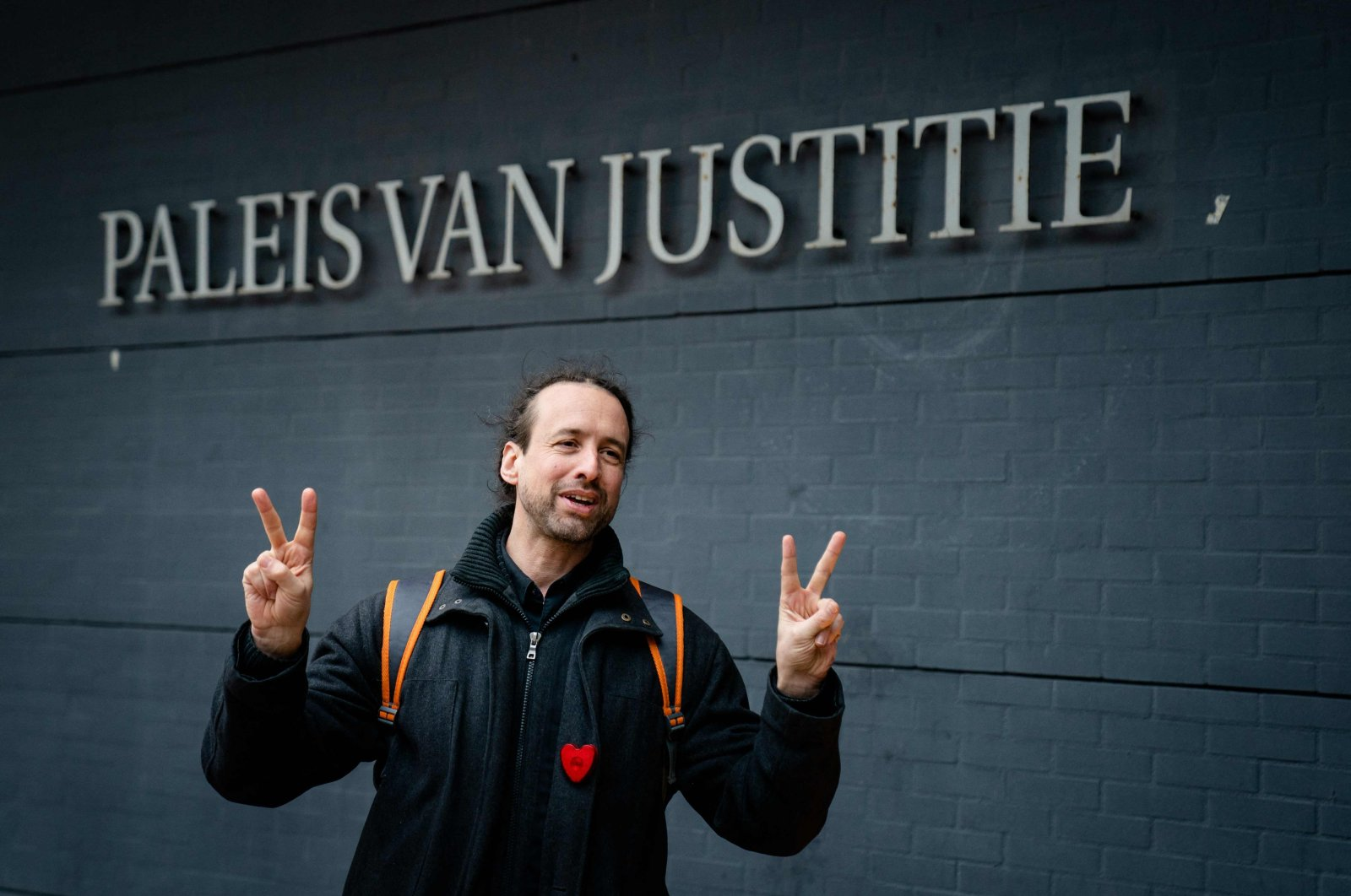 A member of the protest group Viruswaarheid (Virus Truth) Willem Engel arrives at the court of appeal where the Dutch state asked the court to suspend the judge's decision to cancel the nationwide curfew, in The Hague, The Netherlands, Feb. 16, 2021. (AFP Photo)