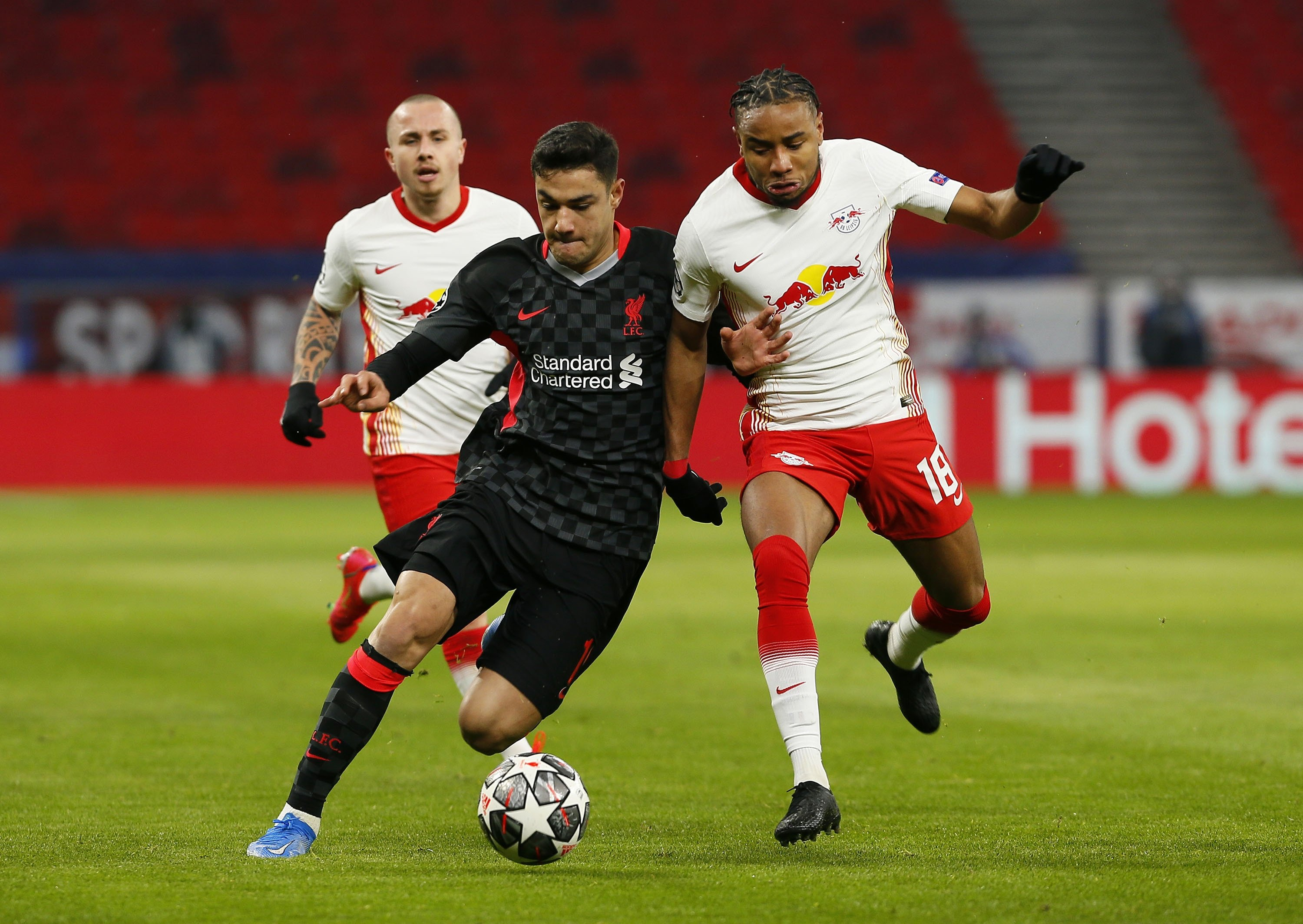 Liverpool's Ozan Kabak (L) and RB Leipzig's Christopher Nkunku (R) battle for the ball during the UEFA Champions League round of 16 match at The Puskas Arena, Budapest, Feb. 16, 2021. (Reuters Photo)