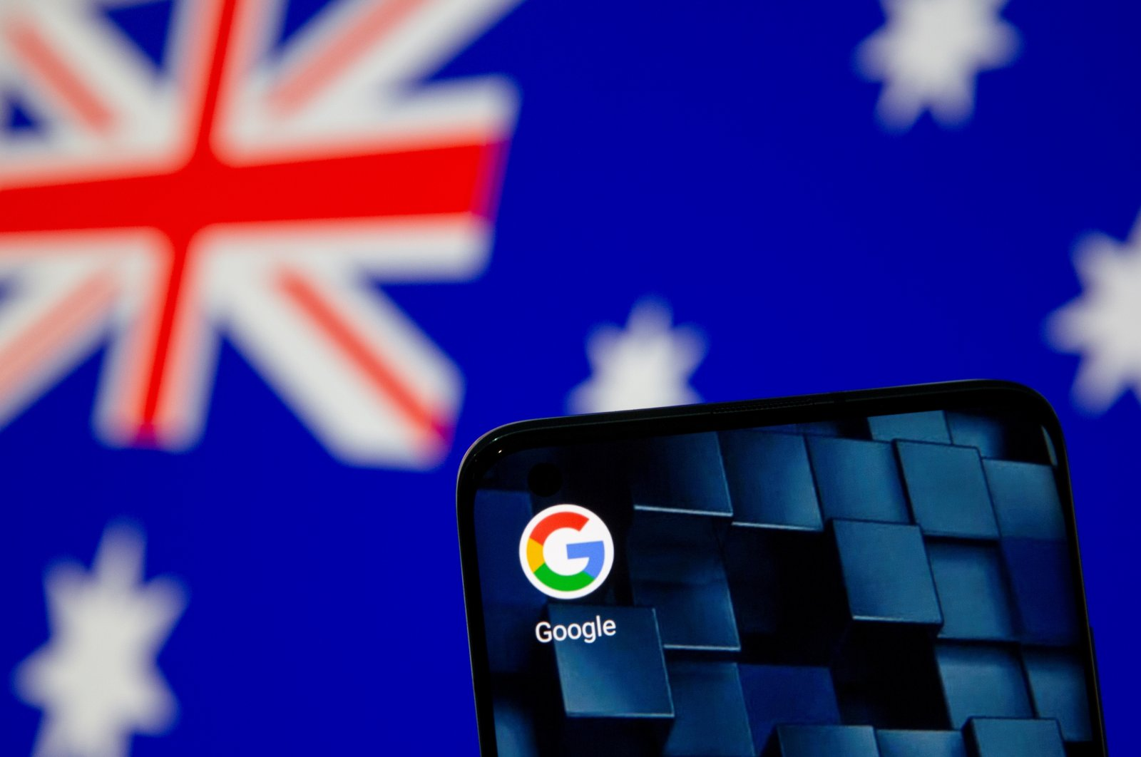 Smartphone with Google app icon is seen in front of the Australian flag in this illustration taken Jan. 22, 2021. (Reuters Photo)