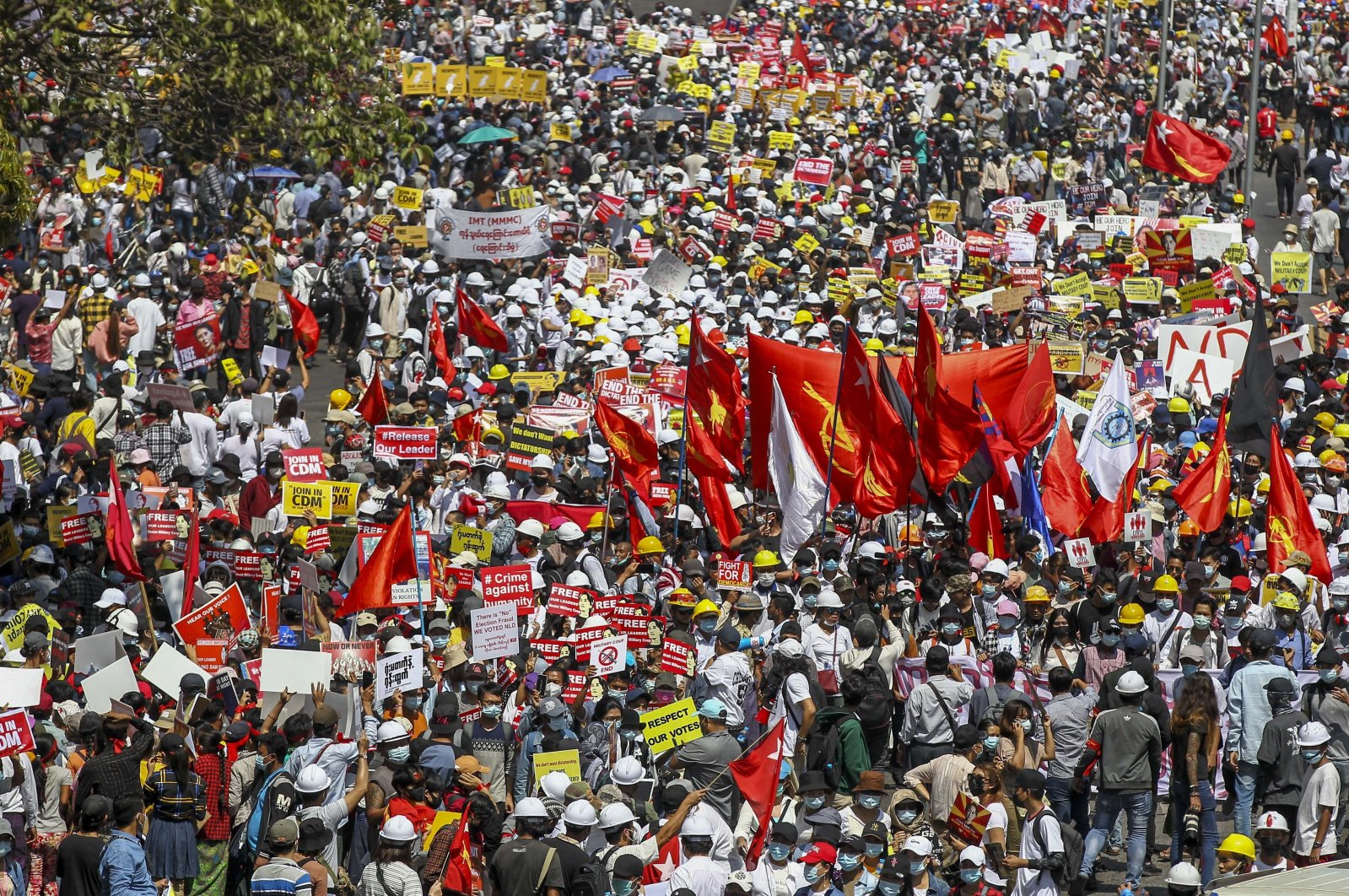 Demonstrators gather at an intersection close to Sule Pagoda to protest against the military coup in Yangon, Myanmar, Feb. 17, 2021. (AP Photo)