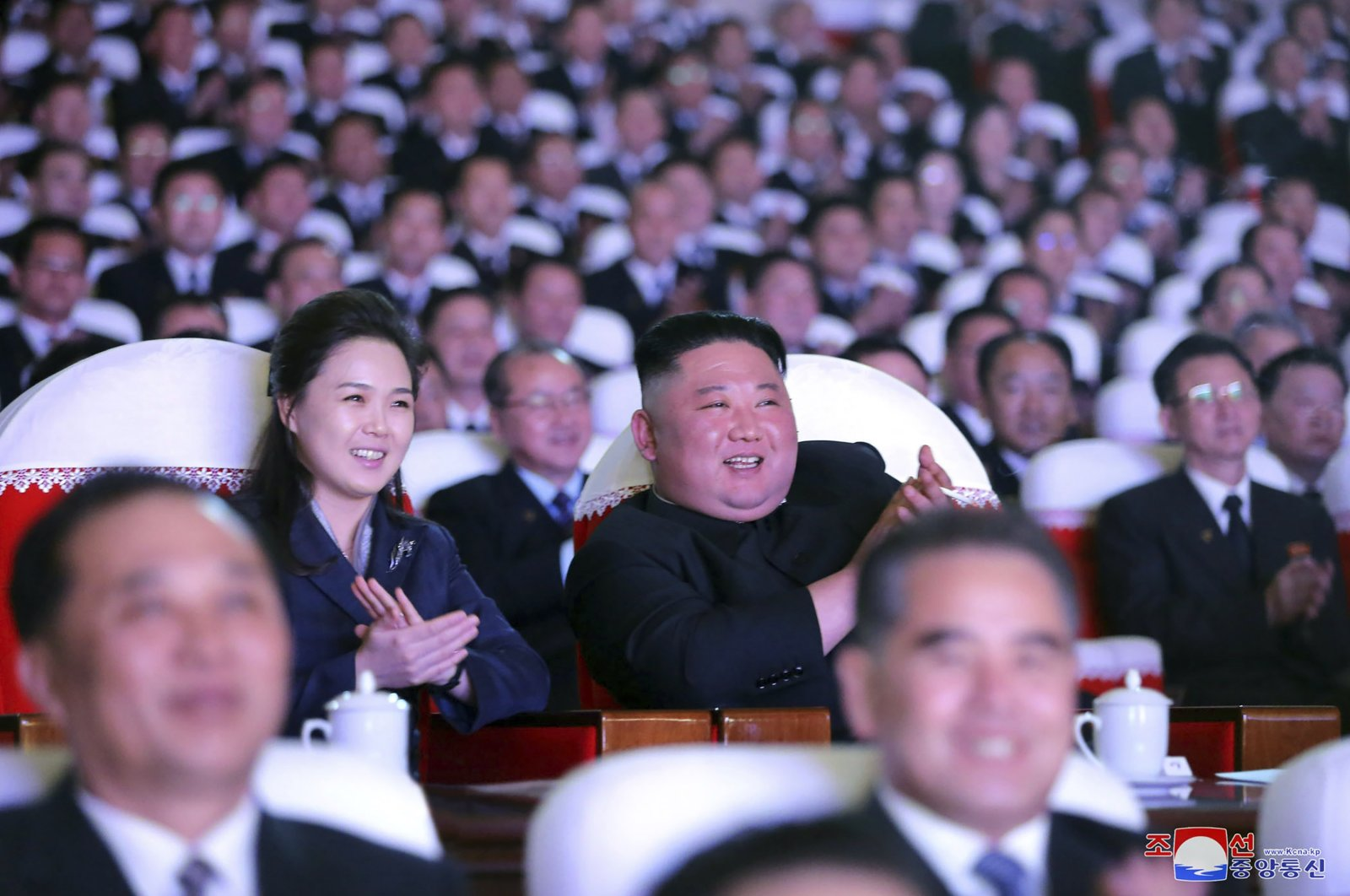 In this photo provided by the North Korean government, North Korean leader Kim Jong Un and his wife Ri Sol Ju watch a performance marking the birth anniversary of Kim Jong Il, Pyongyang, North Korea, Feb. 16, 2021. (AP Photo)