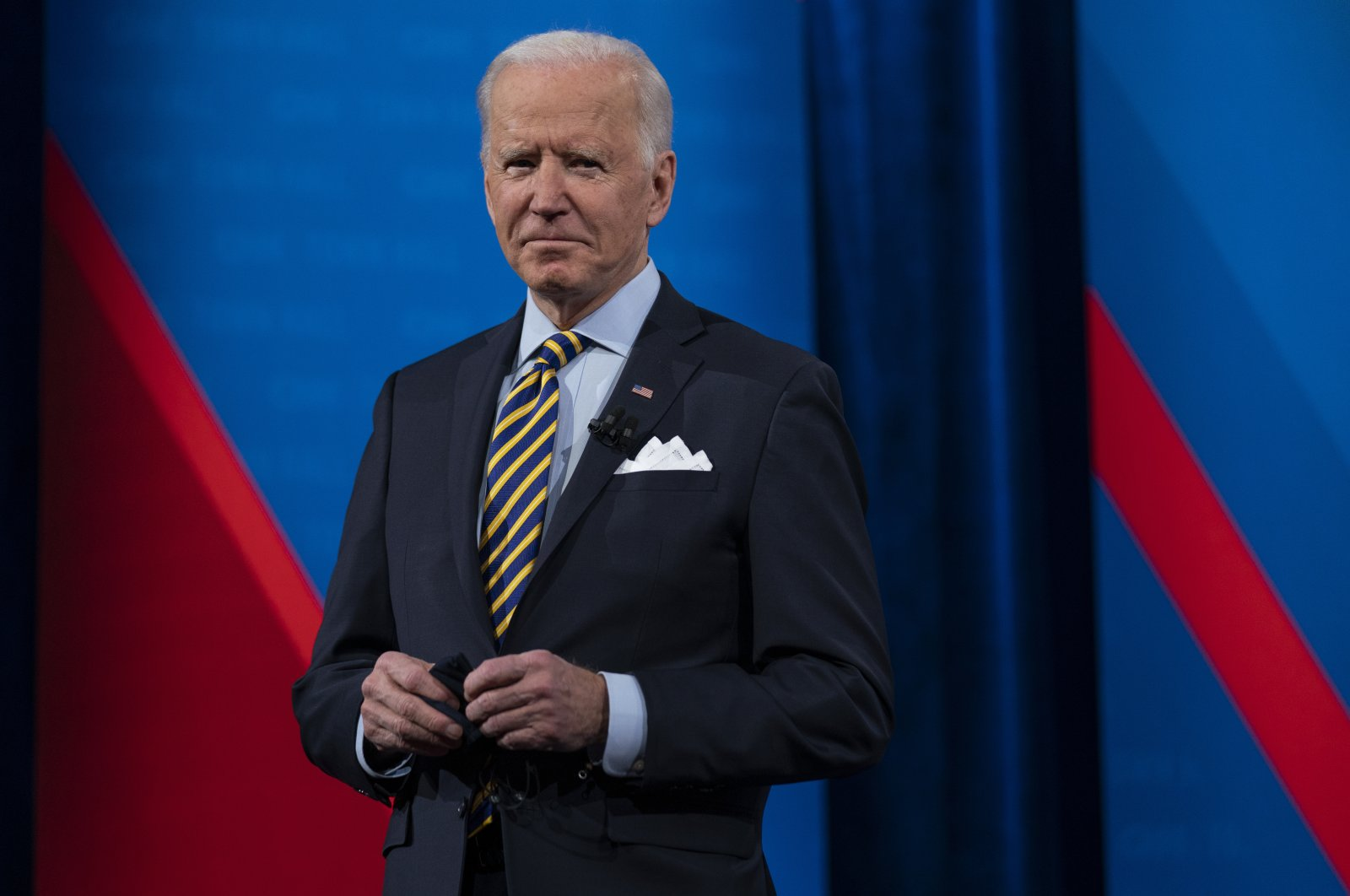 U.S. President Joe Biden talks with audience members as he waits for a commercial break to end during a televised town hall event at Pabst Theater, in Milwaukee, Wisconsin, U.S., Feb. 16, 2021. (AP Photo)