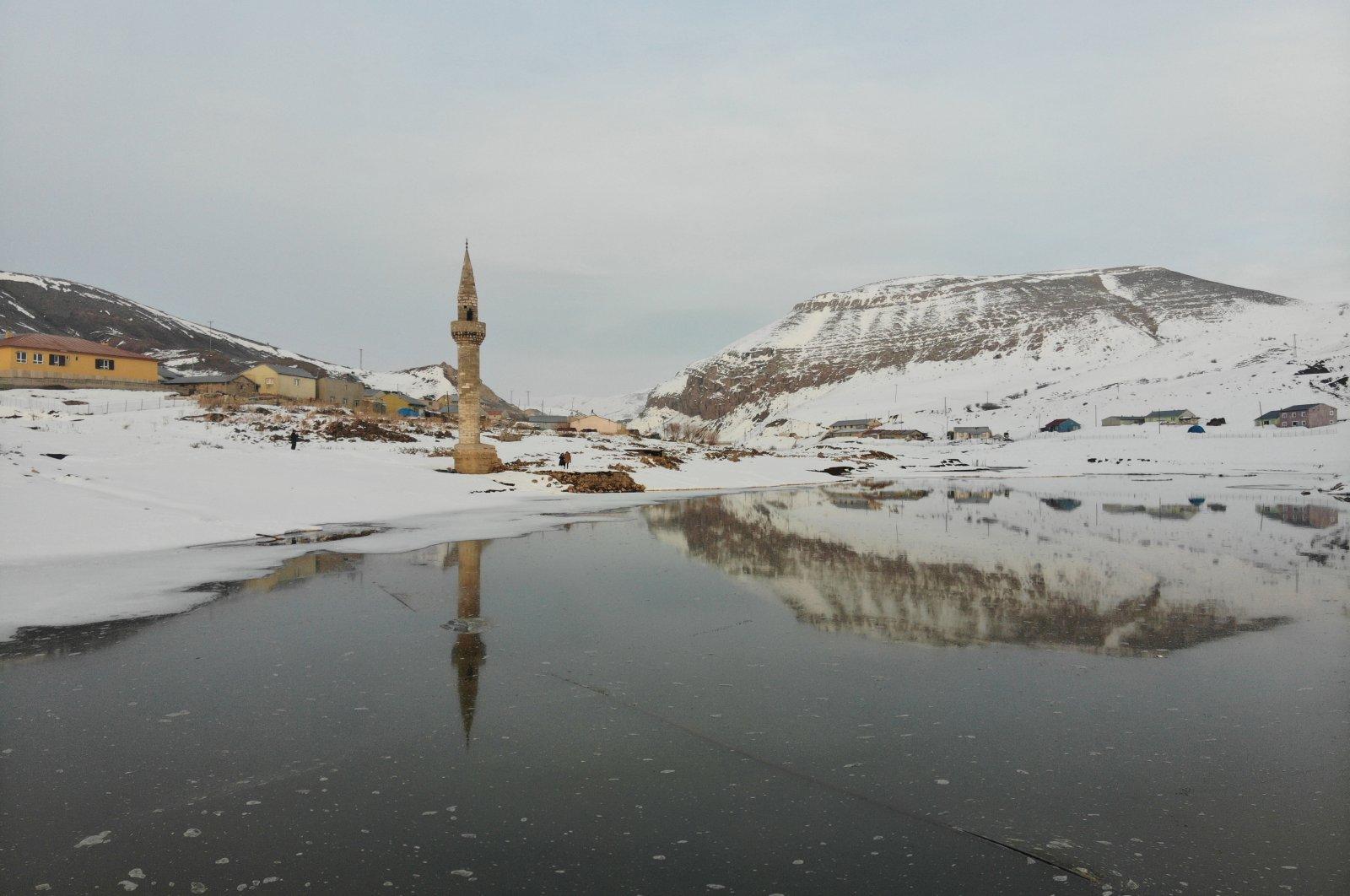 The minaret of a sunken mosque over a frozen dam-lake in Başçavuş village, Ağrı province, eastern Turkey, Feb. 16, 2021. (AA Photo)