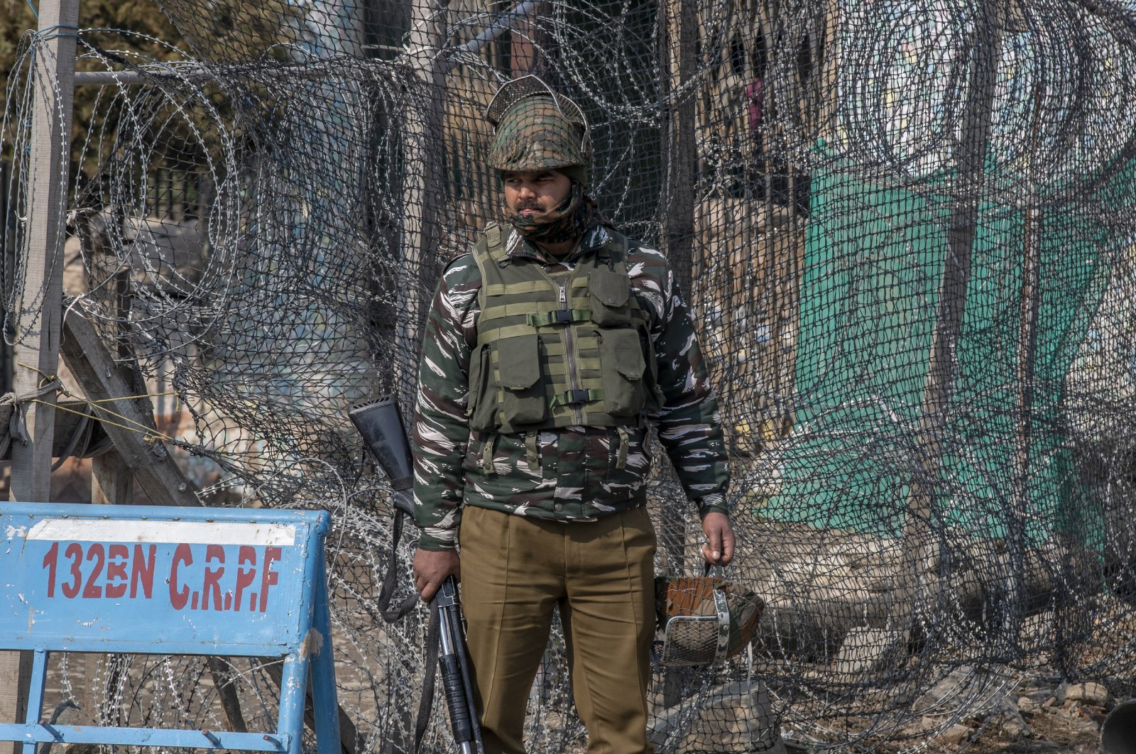 An Indian paramilitary soldier stands guard outside a paramilitary post during a strike to mark the anniversary of Kashmiri leader Maqbool Bhat's death in Srinagar, Indian controlled Kashmir, Feb. 11, 2021. (AP Photo)