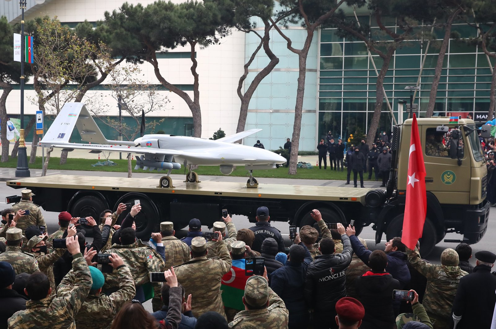A Bayraktar TB2 unmanned combat reconnaissance aerial vehicle manufactured by Turkey's Baykar Makina takes part in a military parade marking the end of the Nagorno Karabakh military conflict, Baku, Azerbaijan, Dec. 10, 2020. (Reuters Photo)