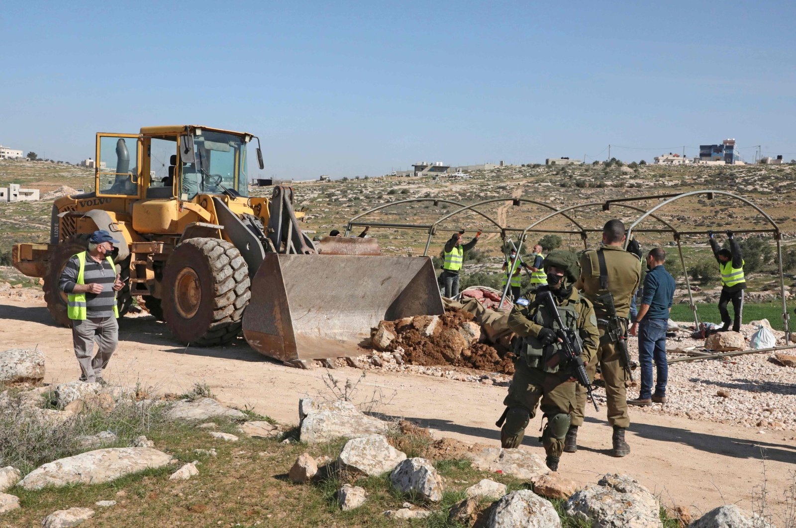 Israeli forces demolish a Palestinian residential tent located within Area C, where Israel retains control, including over planning and construction, in the village of Susya, south of the occupied West Bank city of Hebron, Palestine, Feb. 10, 2021. (AFP Photo)