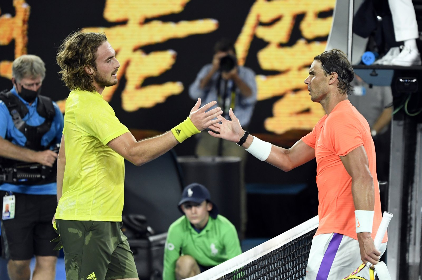 Greece's Stefanos Tsitsipas (L) shakes hands with Spain's Rafael Nadal after winning his Australian Open quarterfinal match, Melbourne, Australia, Feb. 17, 2021. (Reuters Photo)